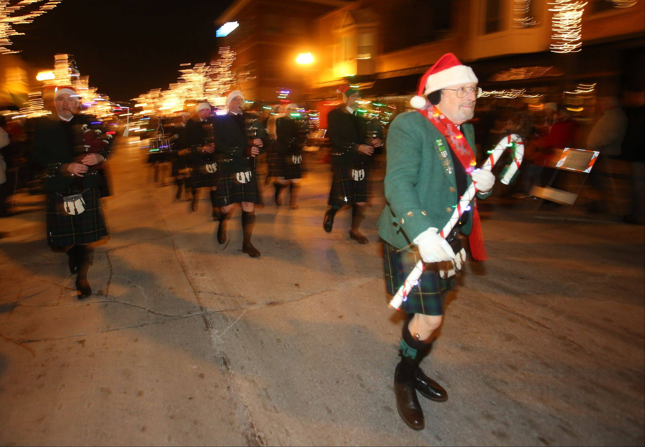 Craig McCould leads the Tunes of Glory during the Wheaton Lighted Holiday Parade on Friday.