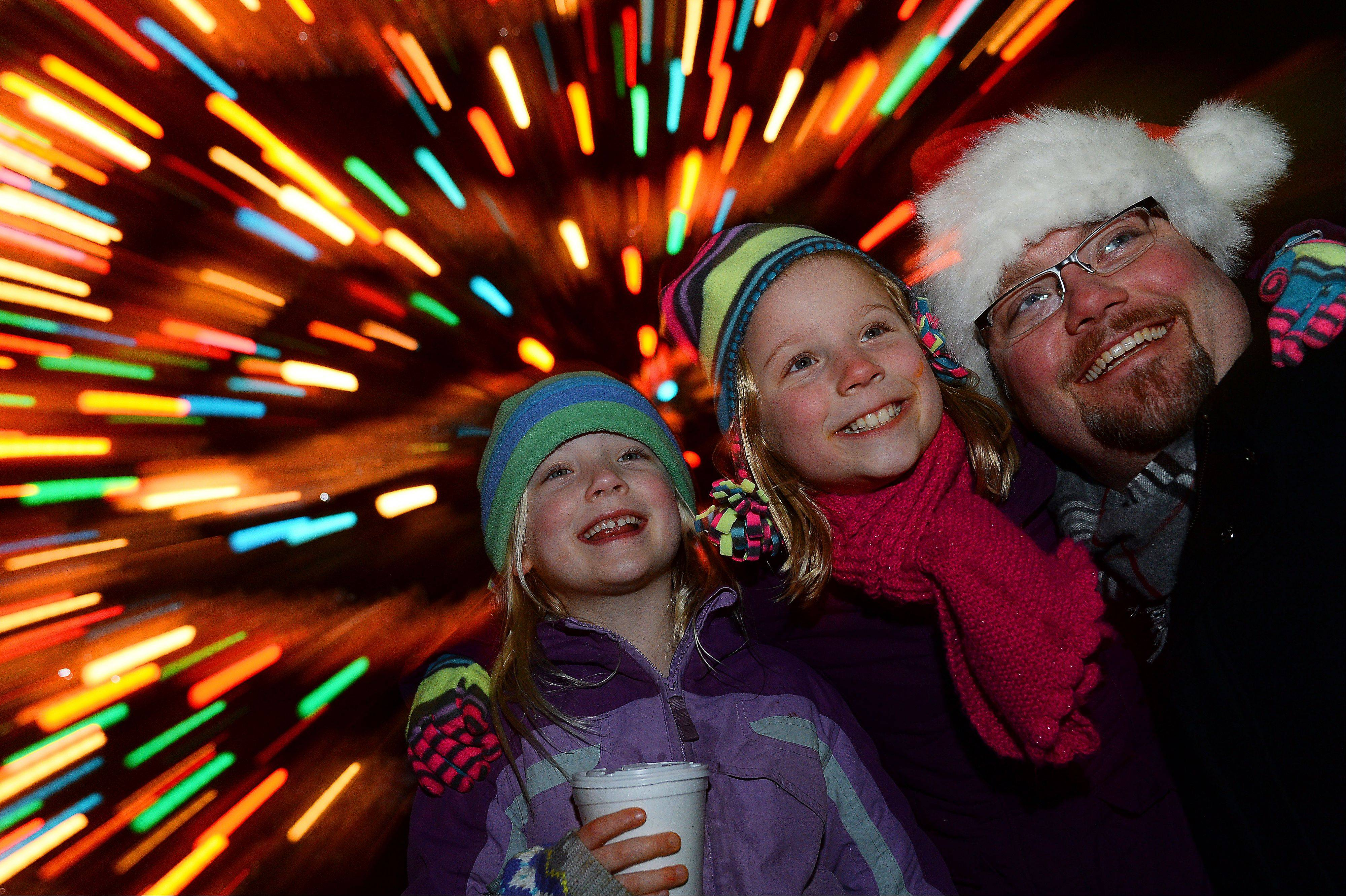Having their picture taken by the Arlington Heights Christmas tree is a tradition for Dave Bixby and daughters, Ania, 6, and Karen, 9, of Arlington Heights.