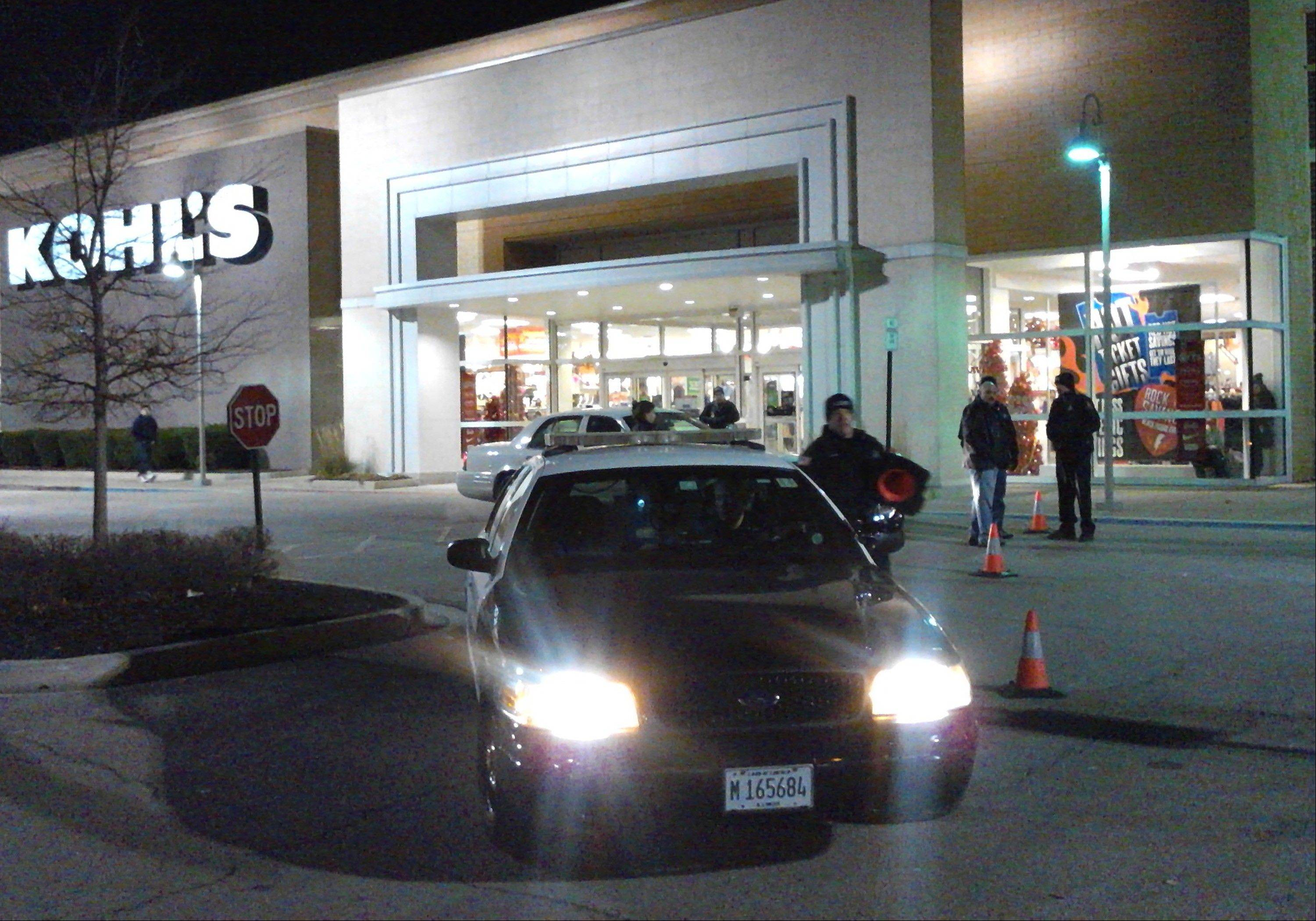 Police respond to a call Thursday at Kohl�s department store on Thanksgiving in Romeoville.