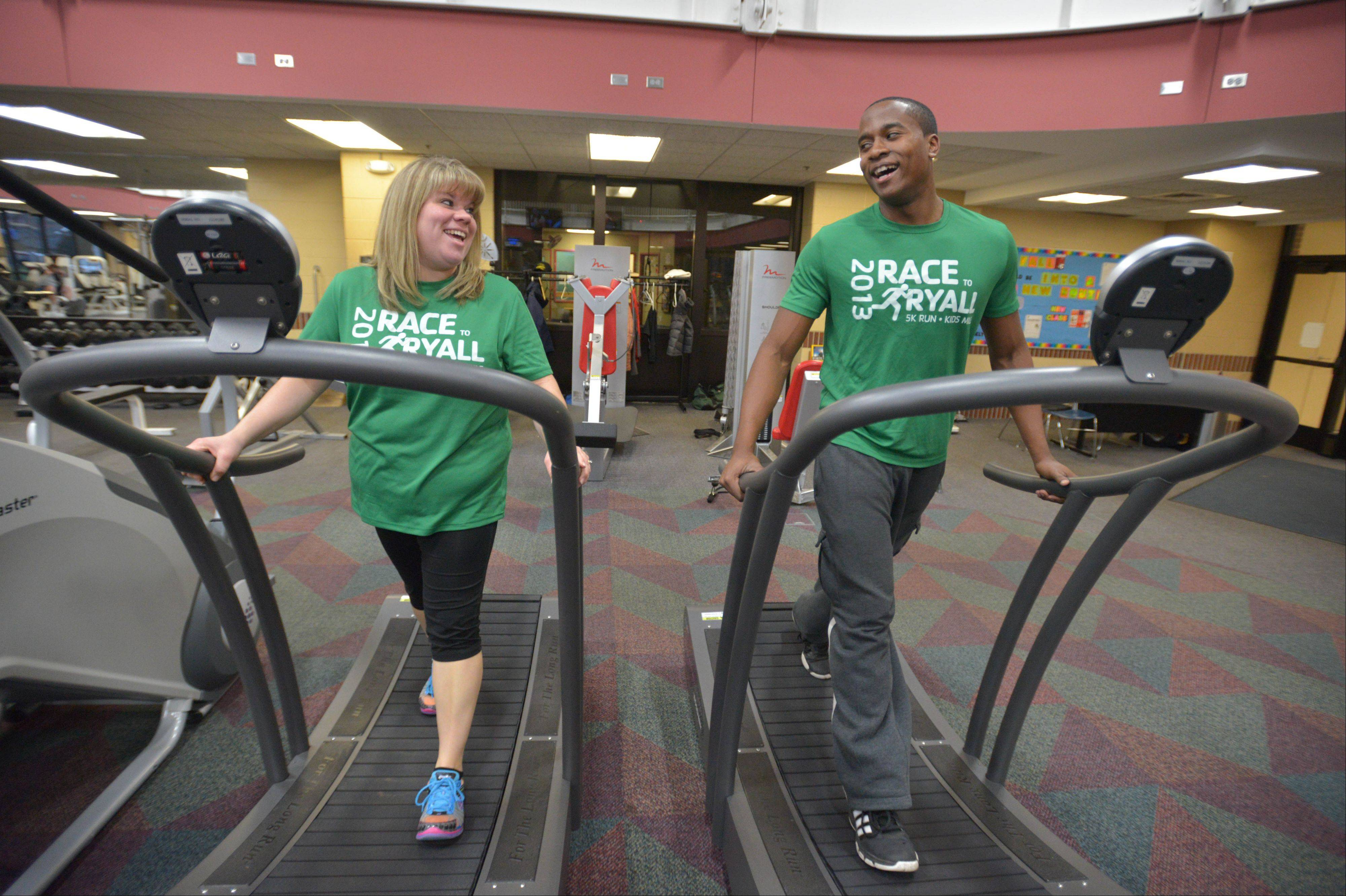 Carl Lane, a 20-year-old College of DuPage student who works at the Glen Ellyn YMCA, jogs with Mandi Leicht of Glen Ellyn. Lane helped Leicht run her first 5K.