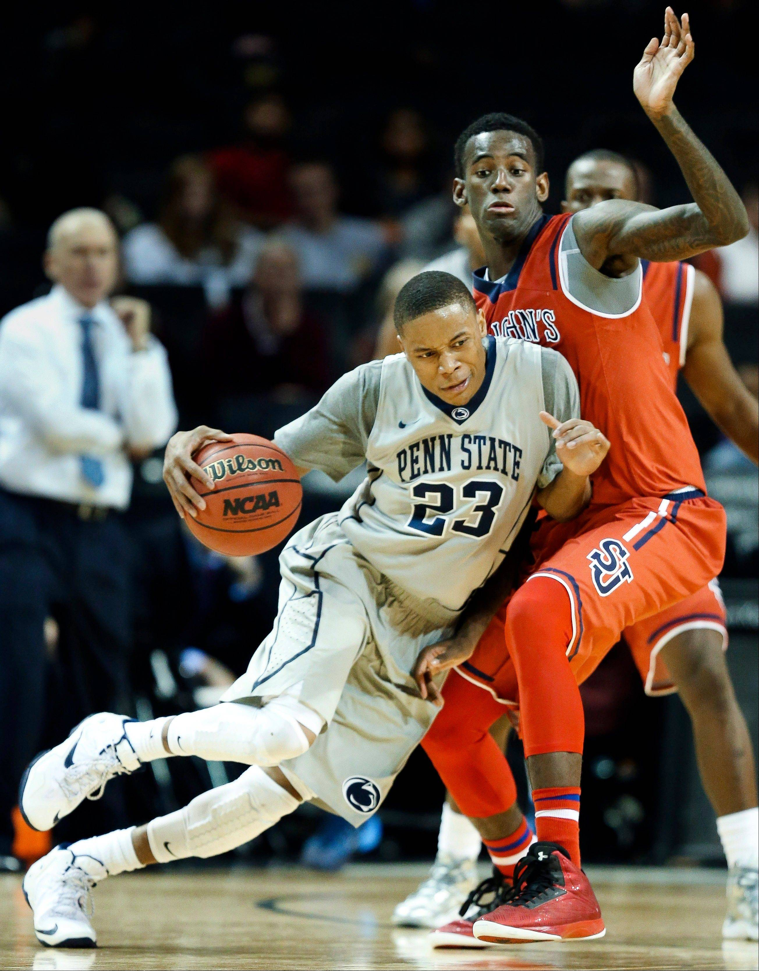 Penn State guard Tim Frazier drives against St. John�s forward Jakarr Sampson in overtime Friday during the Barclays Center Classic in New York.