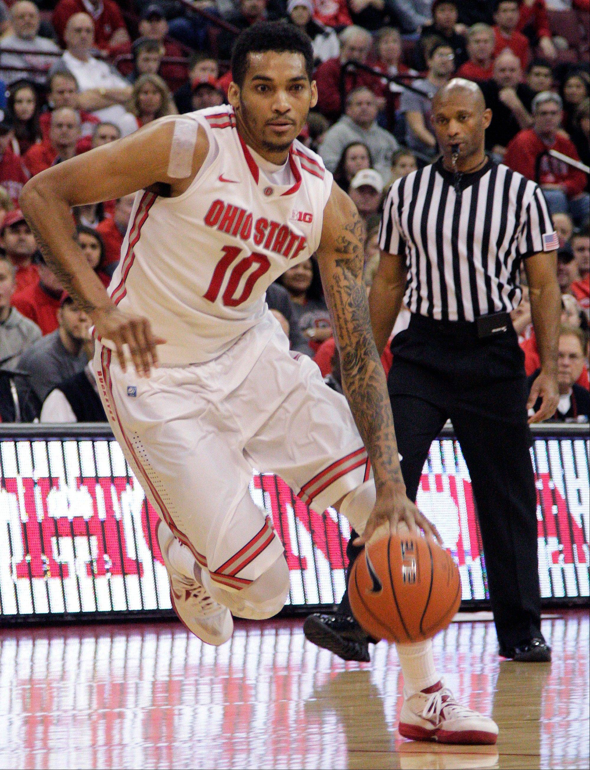 Ohio State�s LaQuinton Ross drives the lane against North Florida during the second half of Friday�s game in Columbus, Ohio.