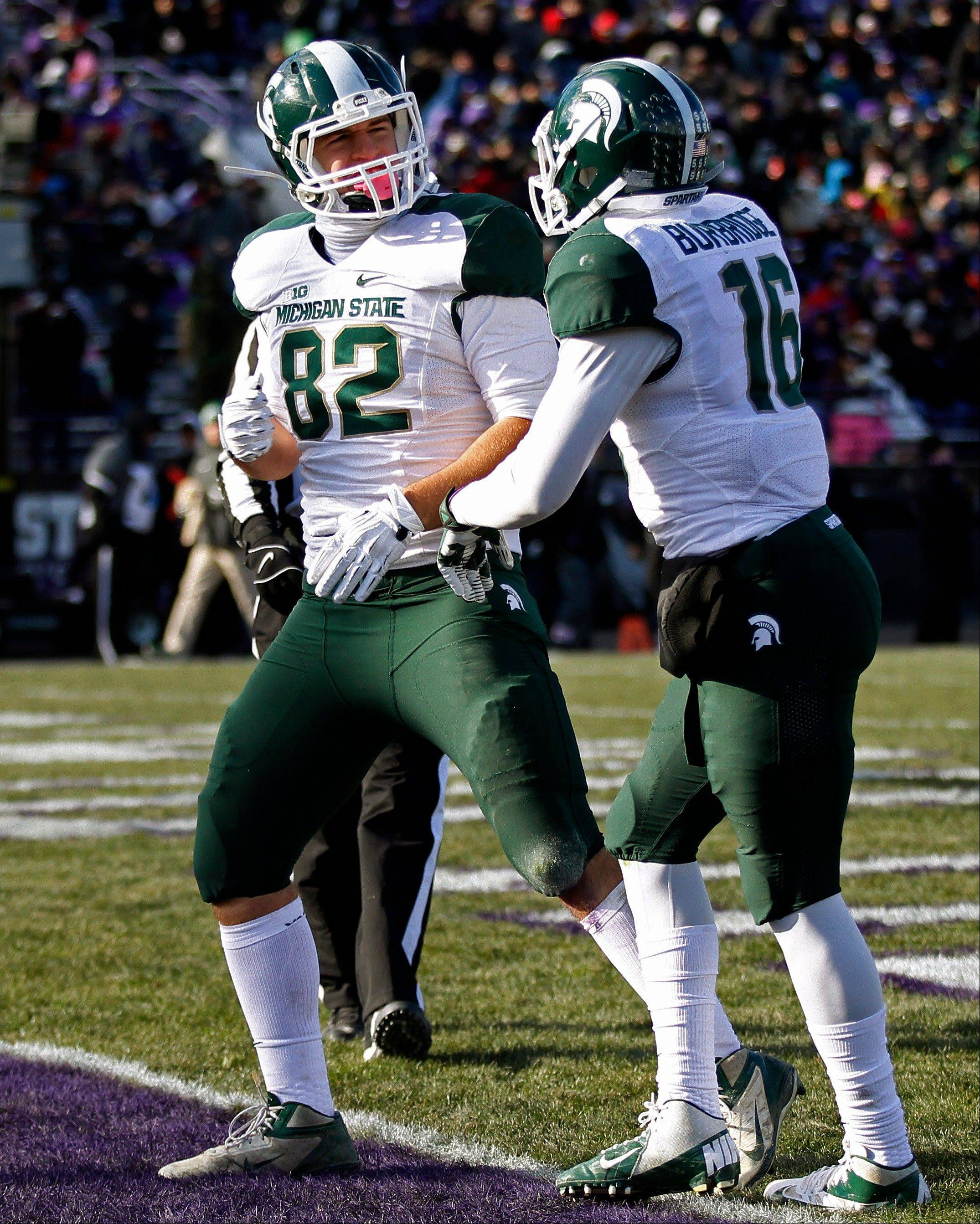 Michigan State tight end Josiah Price (82) celebrates scoring a touchdown with teammate wide receiver Aaron Burbridge (16) during the second half of last Saturday's road win over Northwestern.