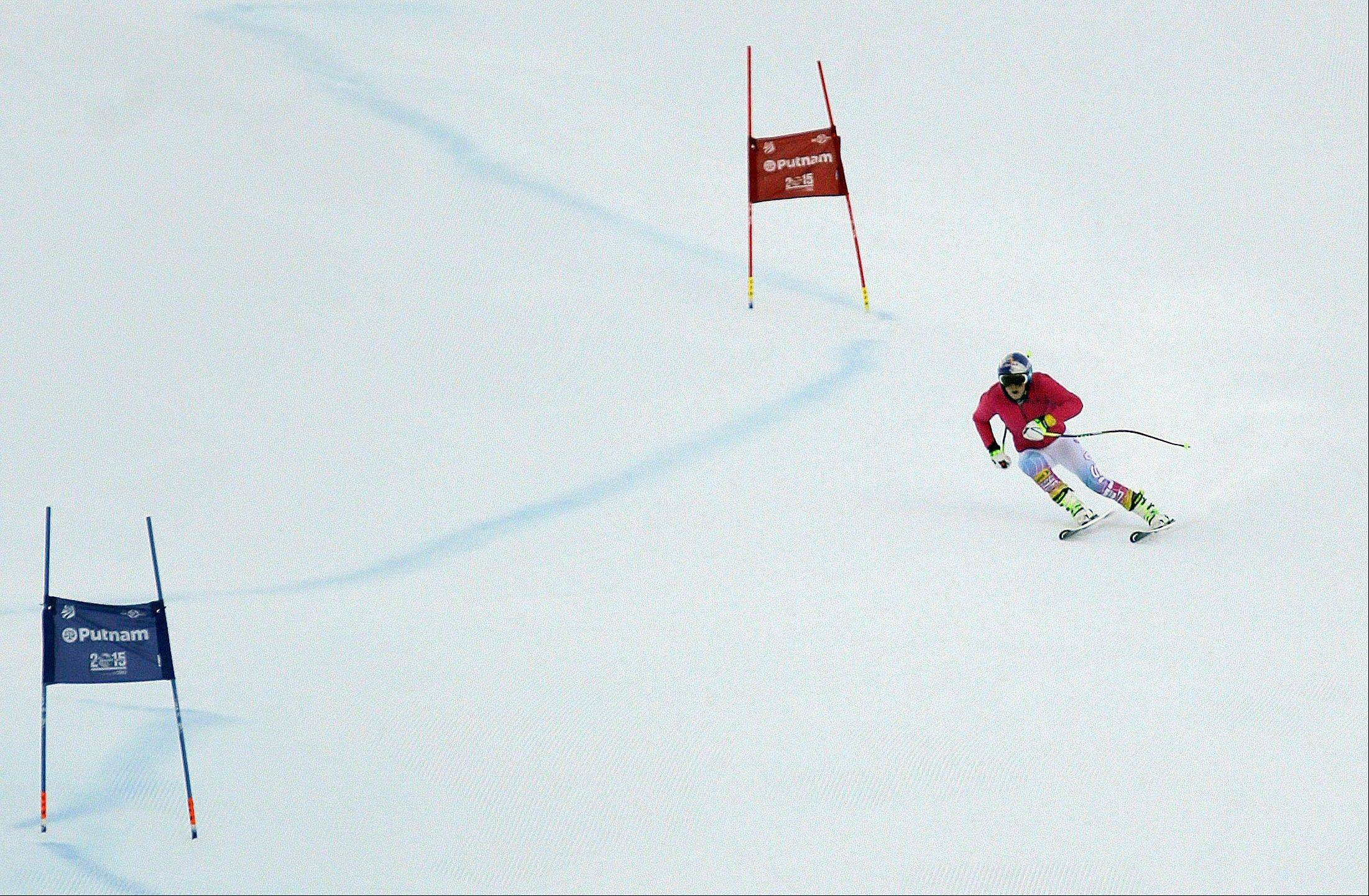 Lindsey Vonn makes a training run down a Super-G course, Friday, Nov. 29, 2013, in Vail, Colo. Vonn was back on the snow for a second day after she partially tore a reconstructed ligament in her right knee during a training mishap in Copper Mountain nine days ago. Although she's skipping the races in Beaver Creek this weekend, the 29-year-old Vonn hasn't ruled out a return to competition in Lake Louise, Alberta, next week. (AP Photo/Julie Jacobson)