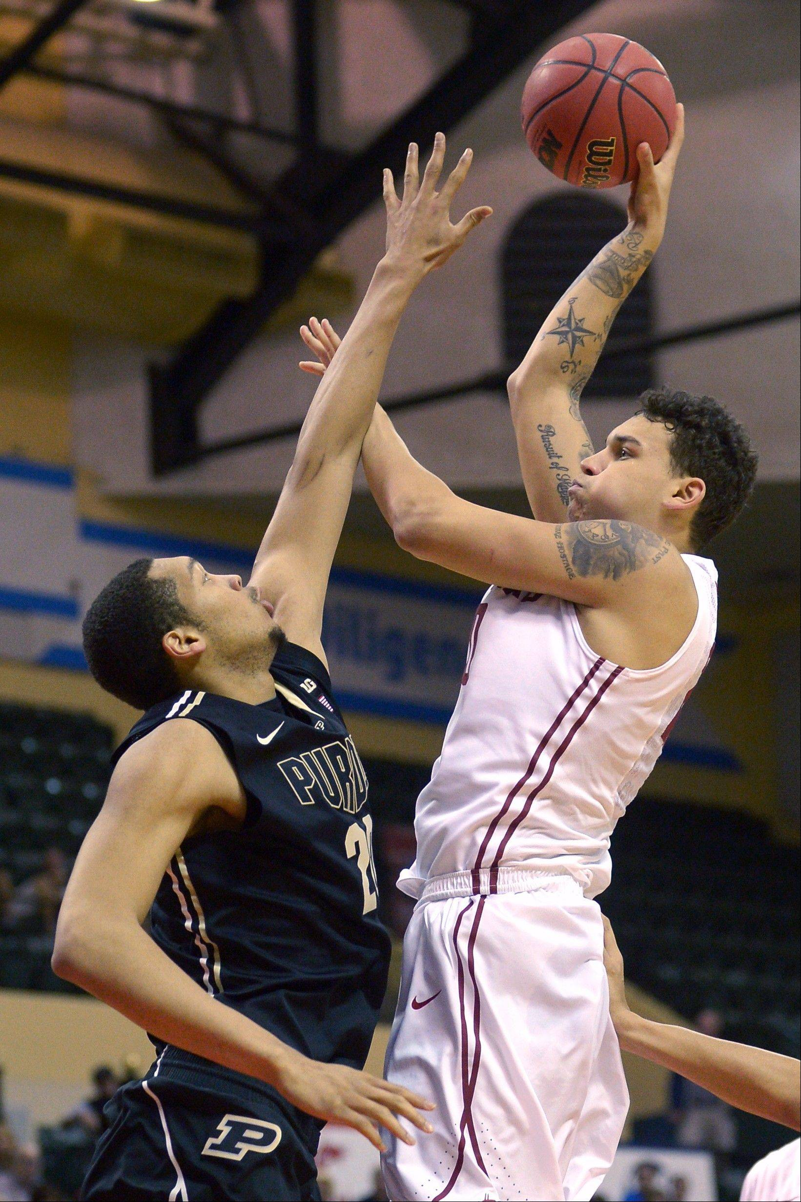 Washington State center Jordan Railey, right, puts up a shot in front of Purdue center A.J. Hammons on Friday at the Old Spice Classic tournament in Kissimmee, Fla.