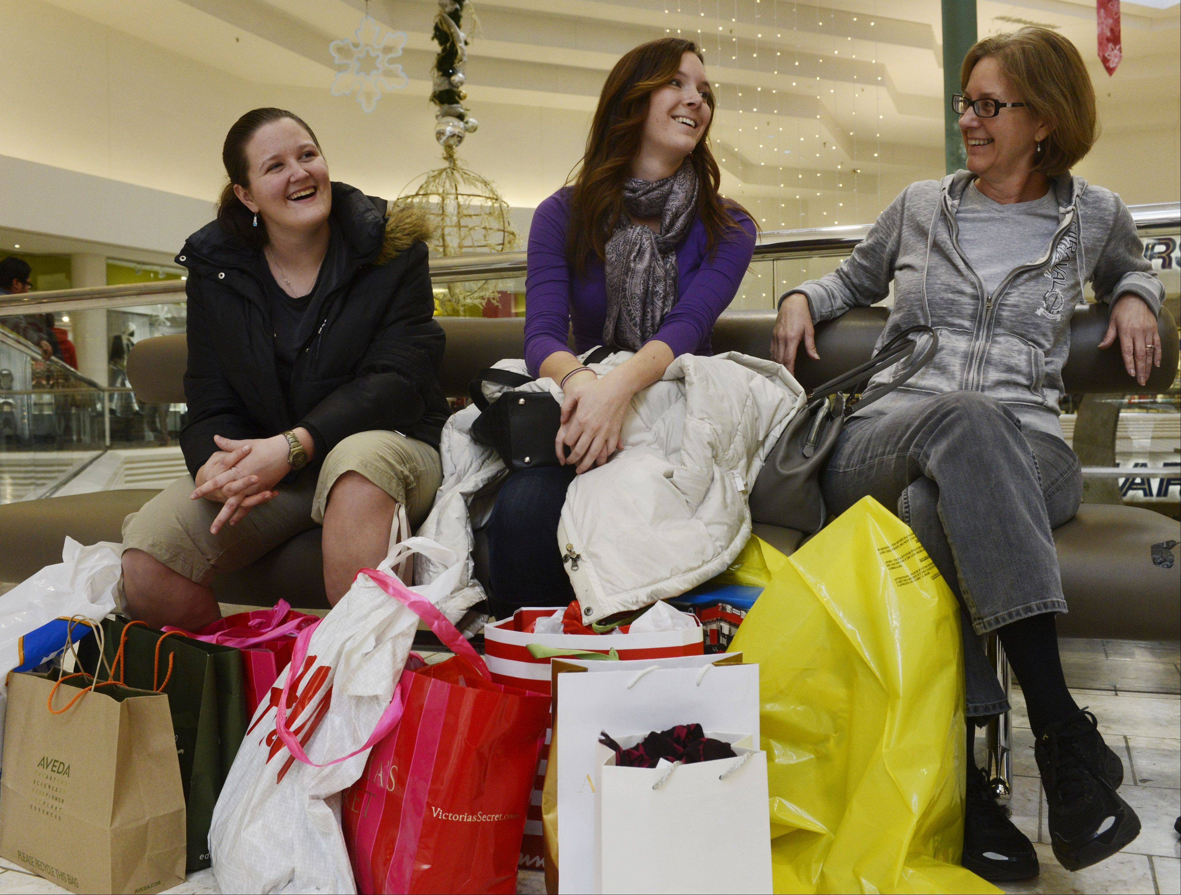 Cally Parkinson, right, of Long Grove relaxes after bargain hunting on Black Friday with her daughter, Charlotte, of Chicago and her niece, K.C. Steussy, who lives outside Indianapolis, Friday at Woodfield Mall in Schaumburg.