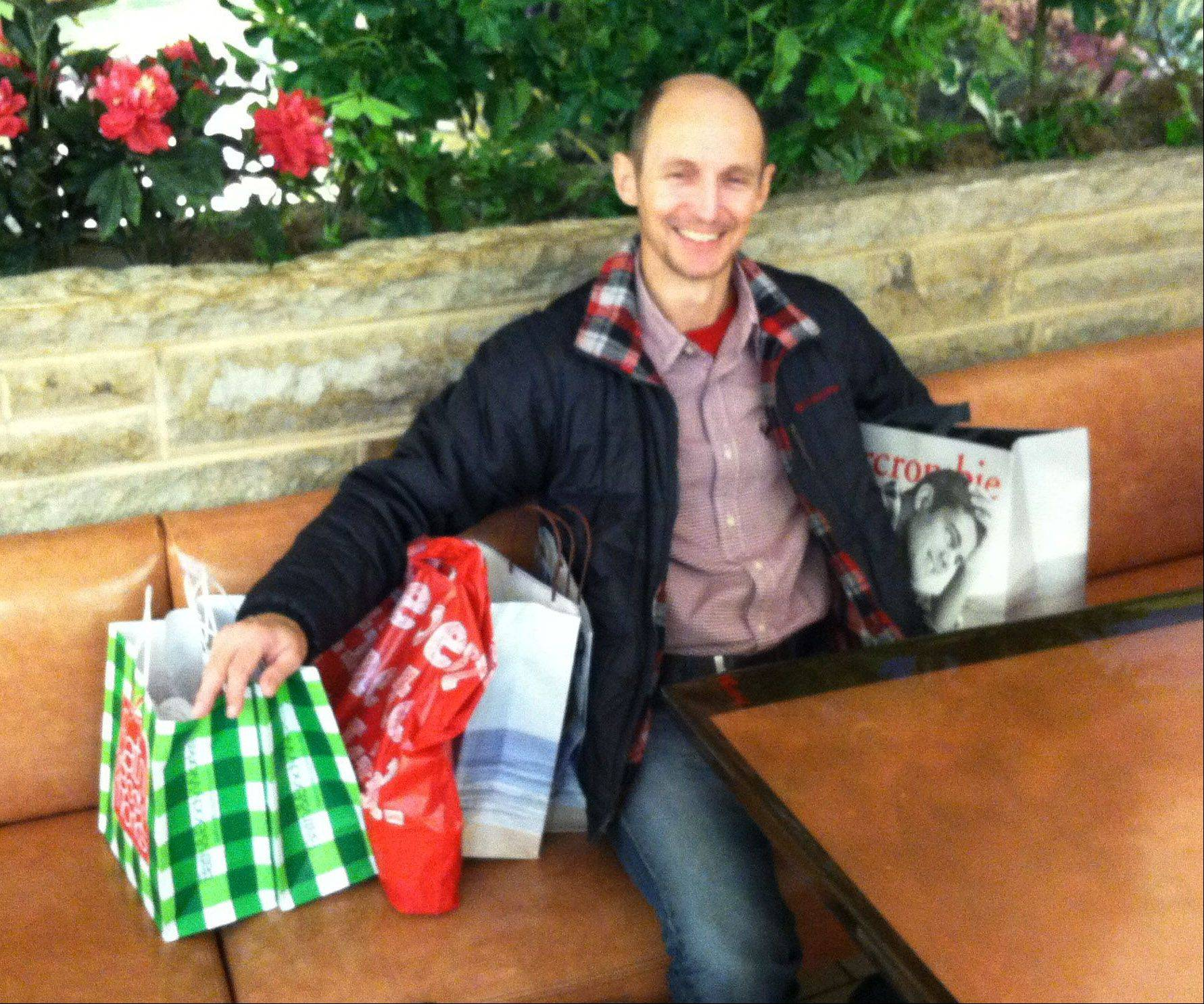 Brady Webb takes a break after finding deals at Westfield Hawthorn Mall in Vernon Hills.
