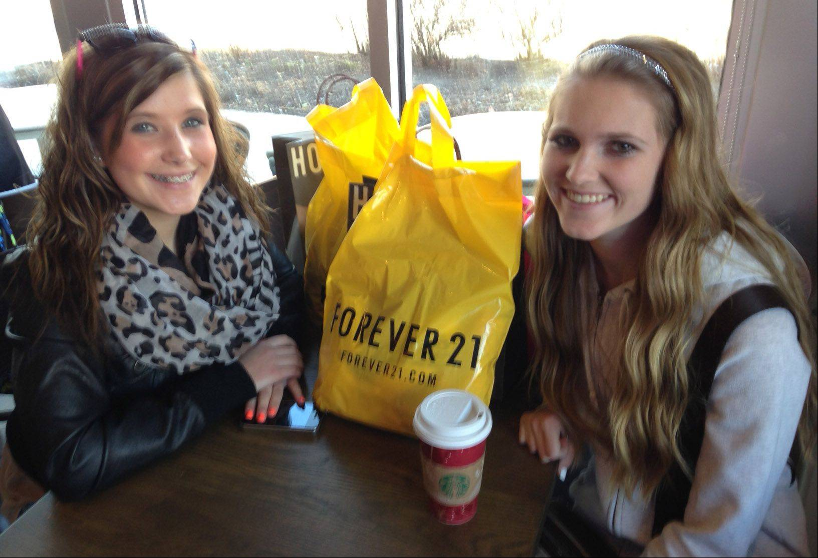 Lexi Friedewald of Bartlett and Kassie Kramer of South Elgin take a break for hot chocolate while shopping Friday morning at Geneva Commons in Geneva. Besides presents for relatives and boyfriends, they picked up a few things for themselves.