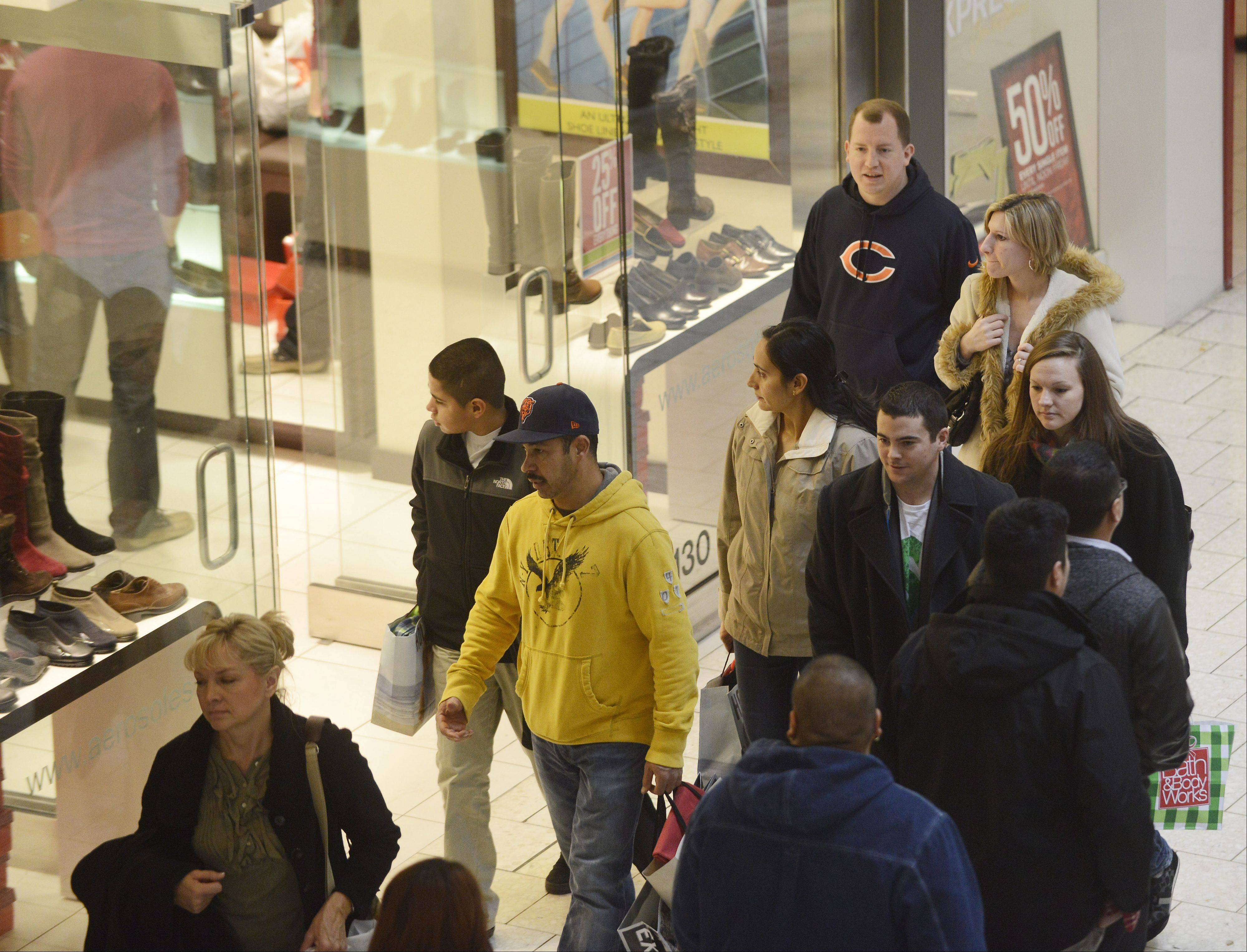 JOE LEWNARD/jlewnard@dailyherald.comShoppers look for deals Friday at Woodfield Mall in Schaumburg.