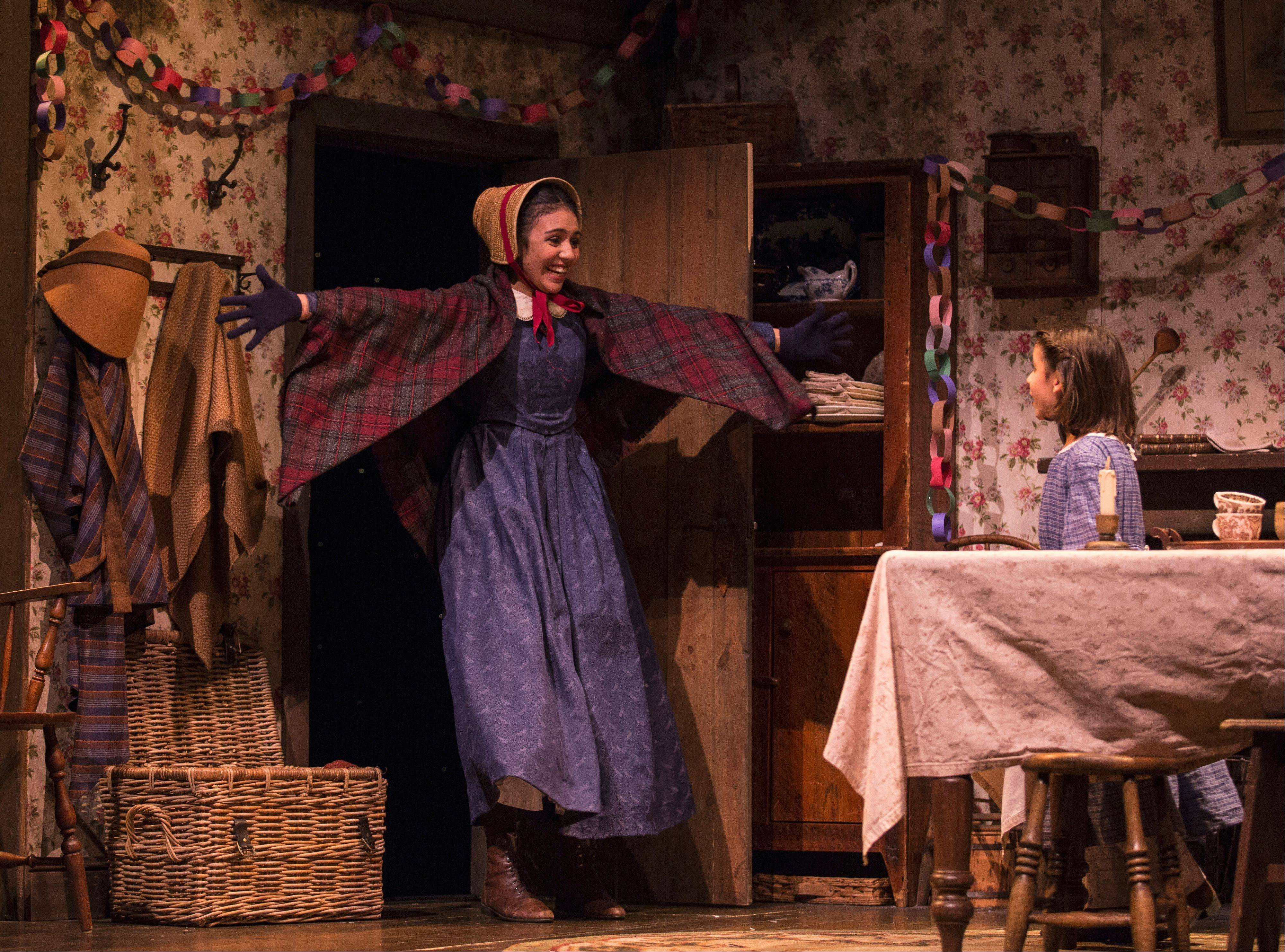 "Haley Bolithon, left, plays Martha Cratchit in Goodman Theatre's ""A Christmas Carol."""
