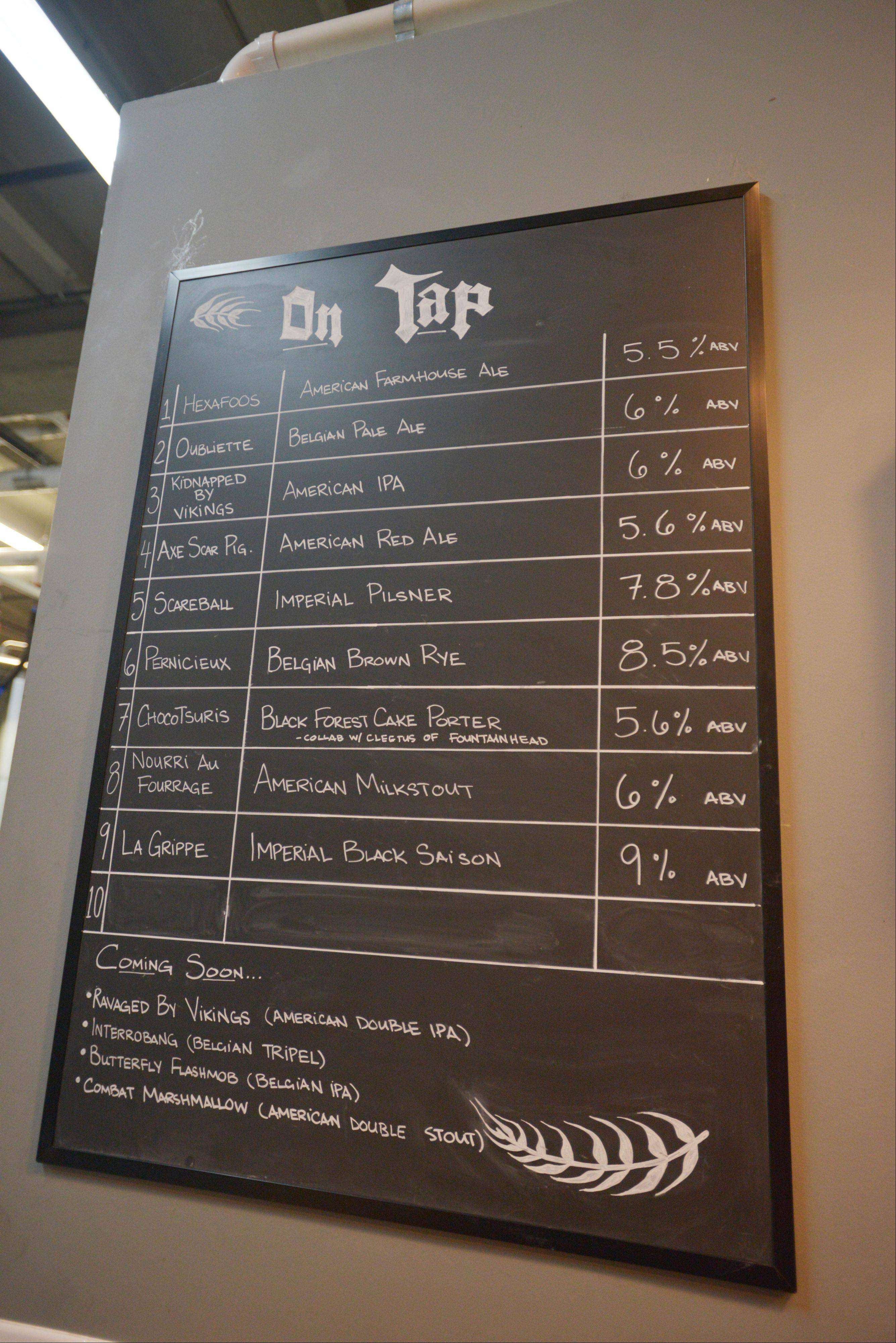 A chalkboard tracks what's on tap at Solemn Oath Brewery in Naperville.