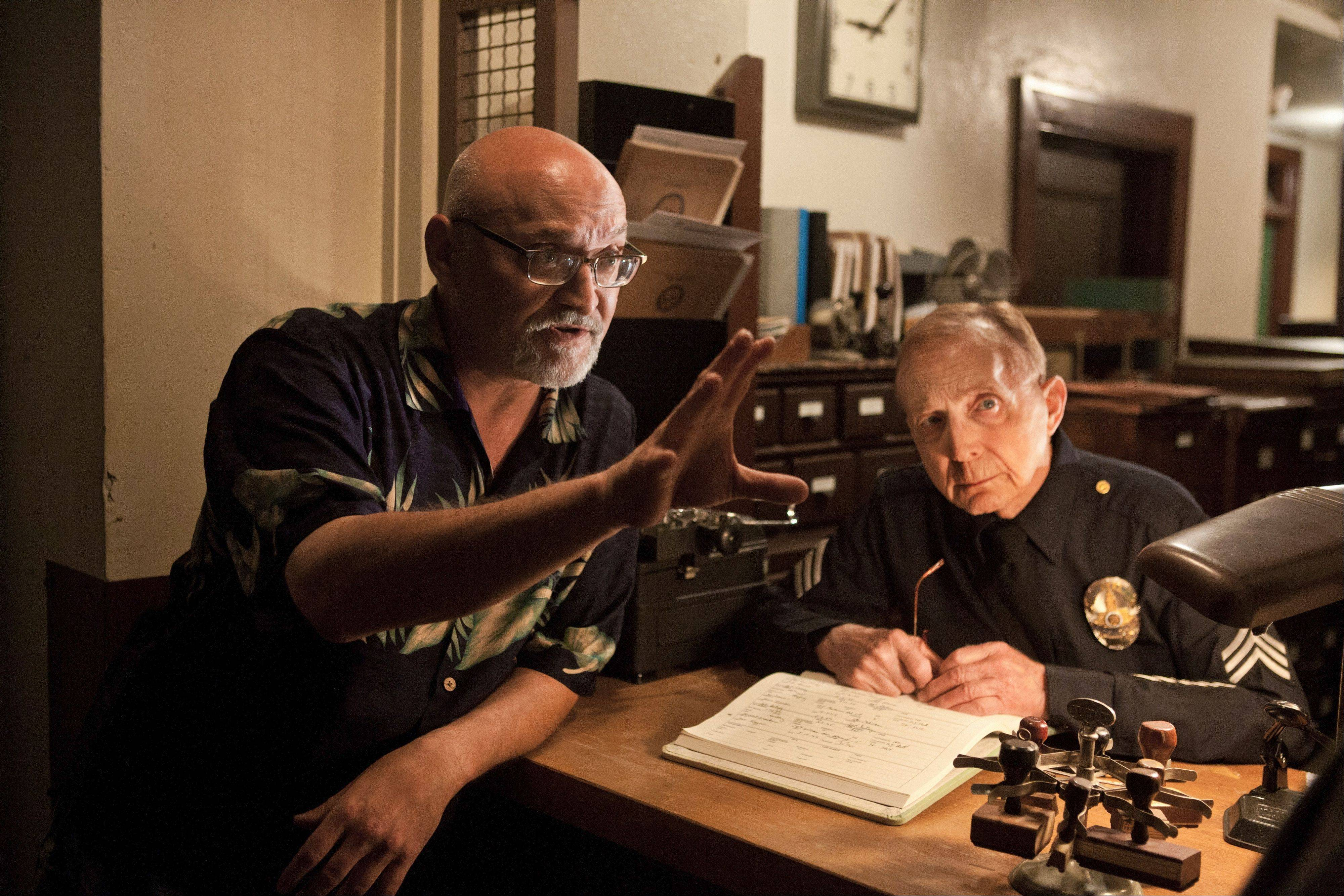 "Frank Darabont, left, directs his cast on the set of ""Mob City,"" premiering Wednesday, Dec. 4, on TNT."