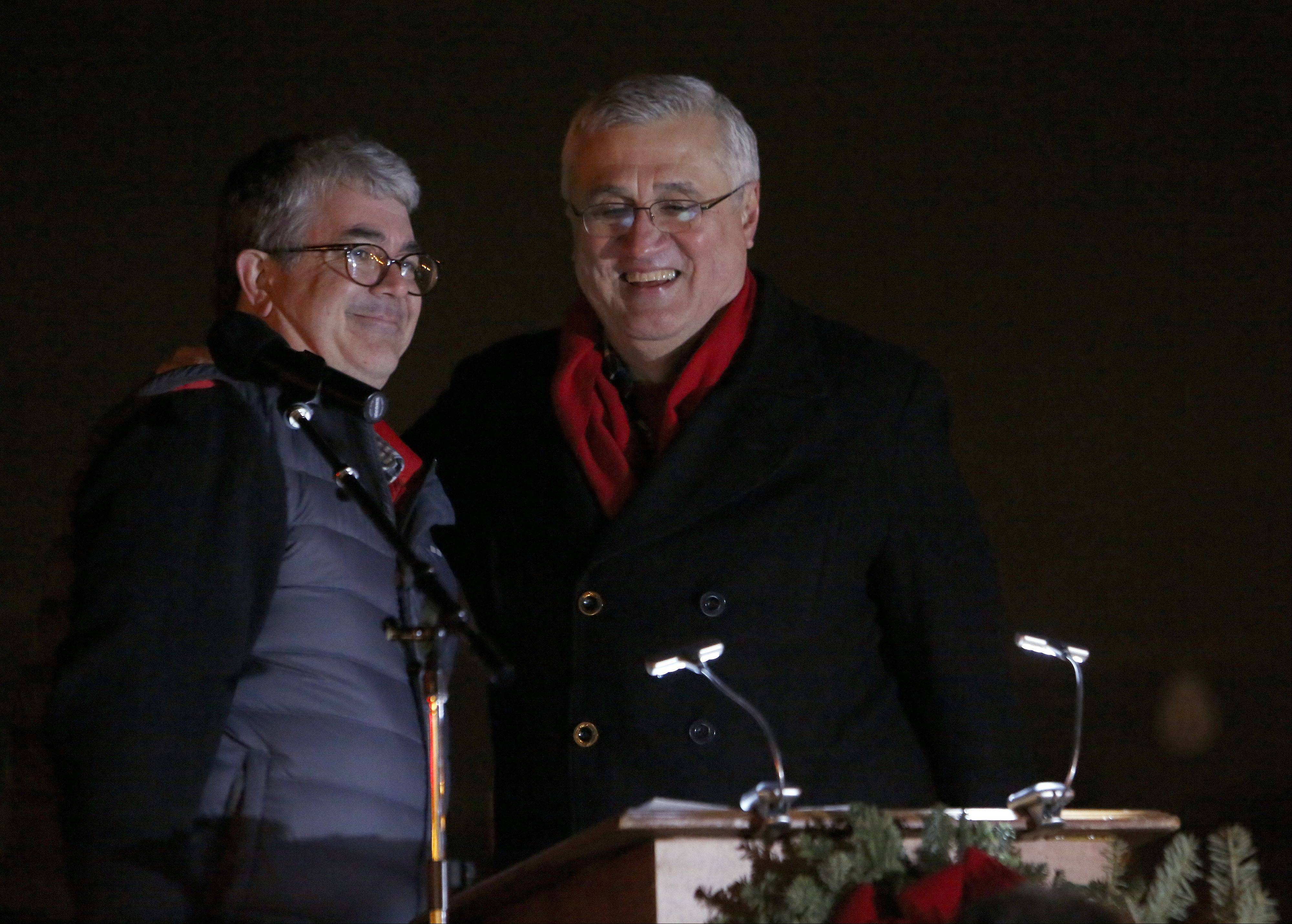 "St. Charles Mayor Ray Rogina shares a laugh and a hug with ""In St. Charles"" songwriter Jim Masters during the ceremony."