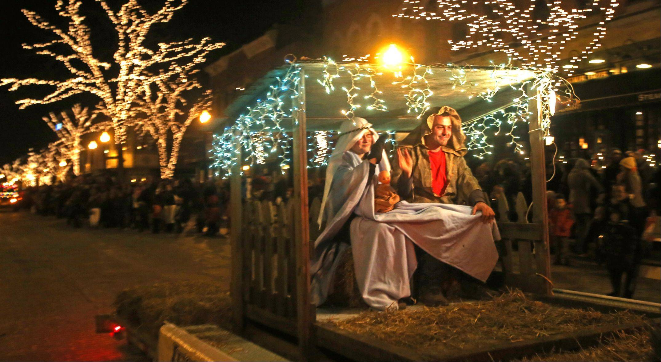 Daniel White/dwhite@dailyherald.comA nativity scene sponsored by Wheaton Nursery makes its way down Front Street during the Wheaton Lighted Holiday Parade.