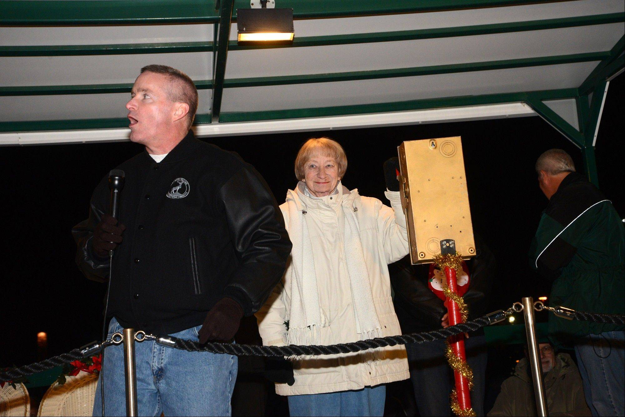 Former Elk Grove Township Supervisor Nanci Vanderwheel stands ready to flip the switch at Mayor Craig Johnson's direction Friday night during Elk Grove Village's tree-lighting ceremony.
