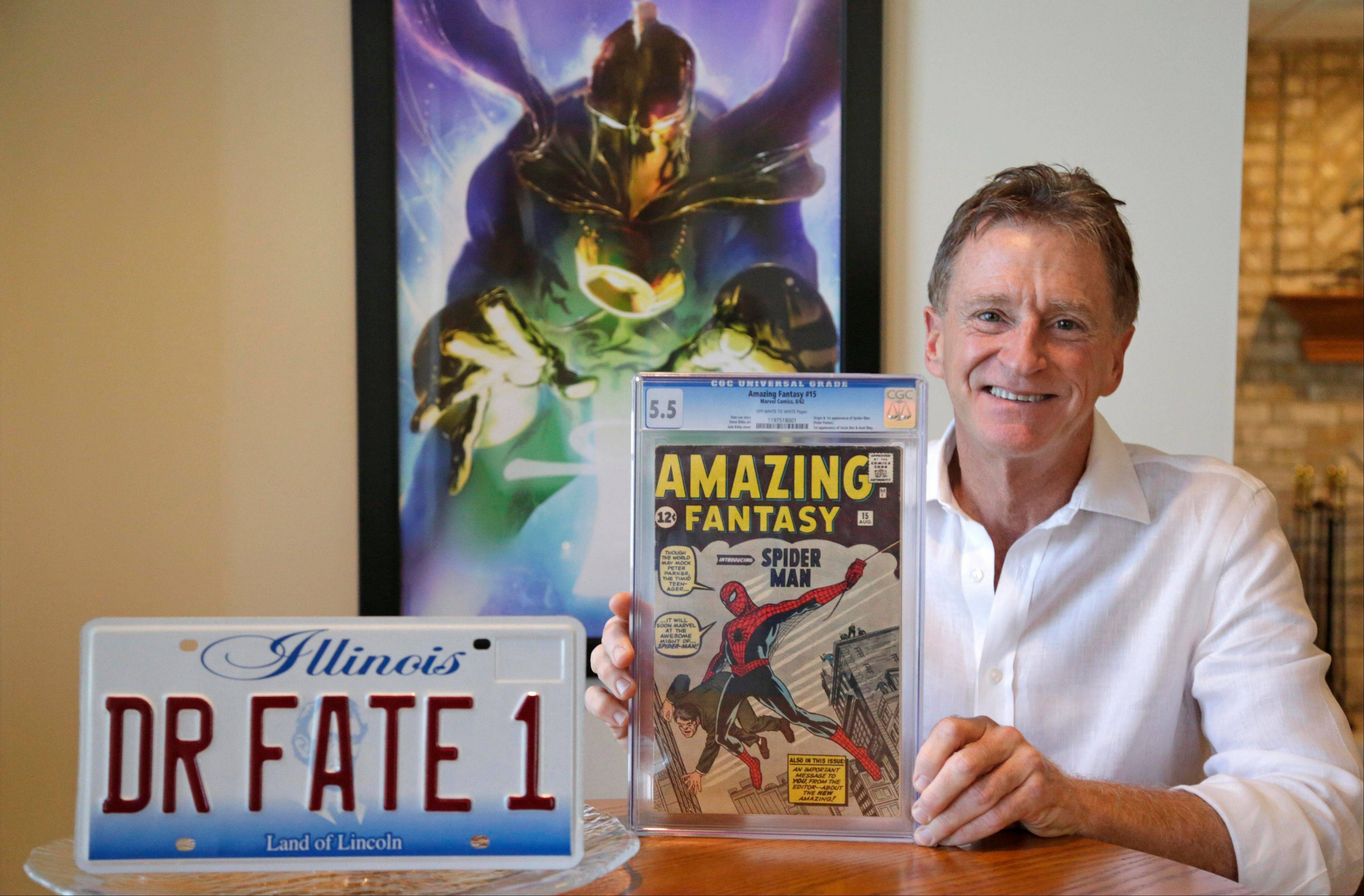 Steve Landman poses with one of his collectible comic books, a vanity license plate with the name of a childhood superhero on it, and a poster of the same superhero, Dr. Fate, at his home in Kildeer. Landman is selling hundreds of his comic books in an online auction that could bring in over $750,000 for his family and, more importantly, raise awareness about the disease that is robbing him of his mobility and profession.