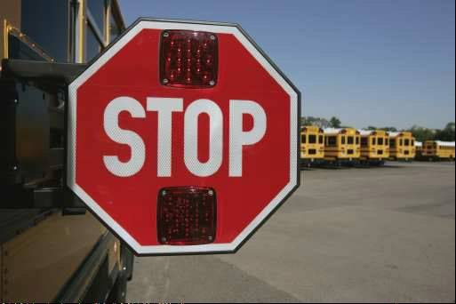 Prospect Heights Elementary District 23 school buses will soon be equipped with more than just stop signs - they'll have cameras that shoot photos of vehicles that illegally pass.