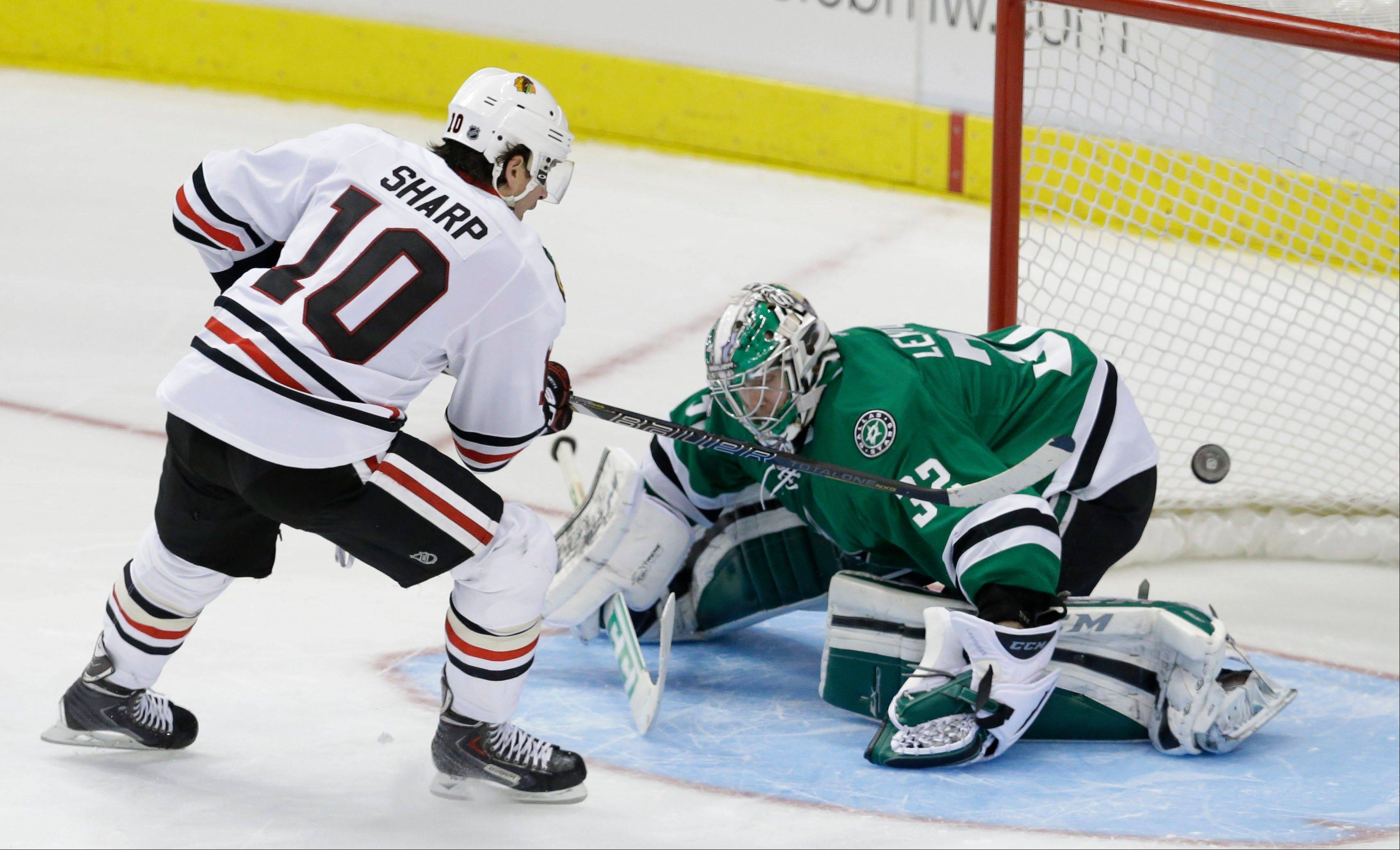 The Blackhawks' Patrick Sharp beats Stars goalie Kari Lehtonen (32) during a shootout Friday in Dallas.