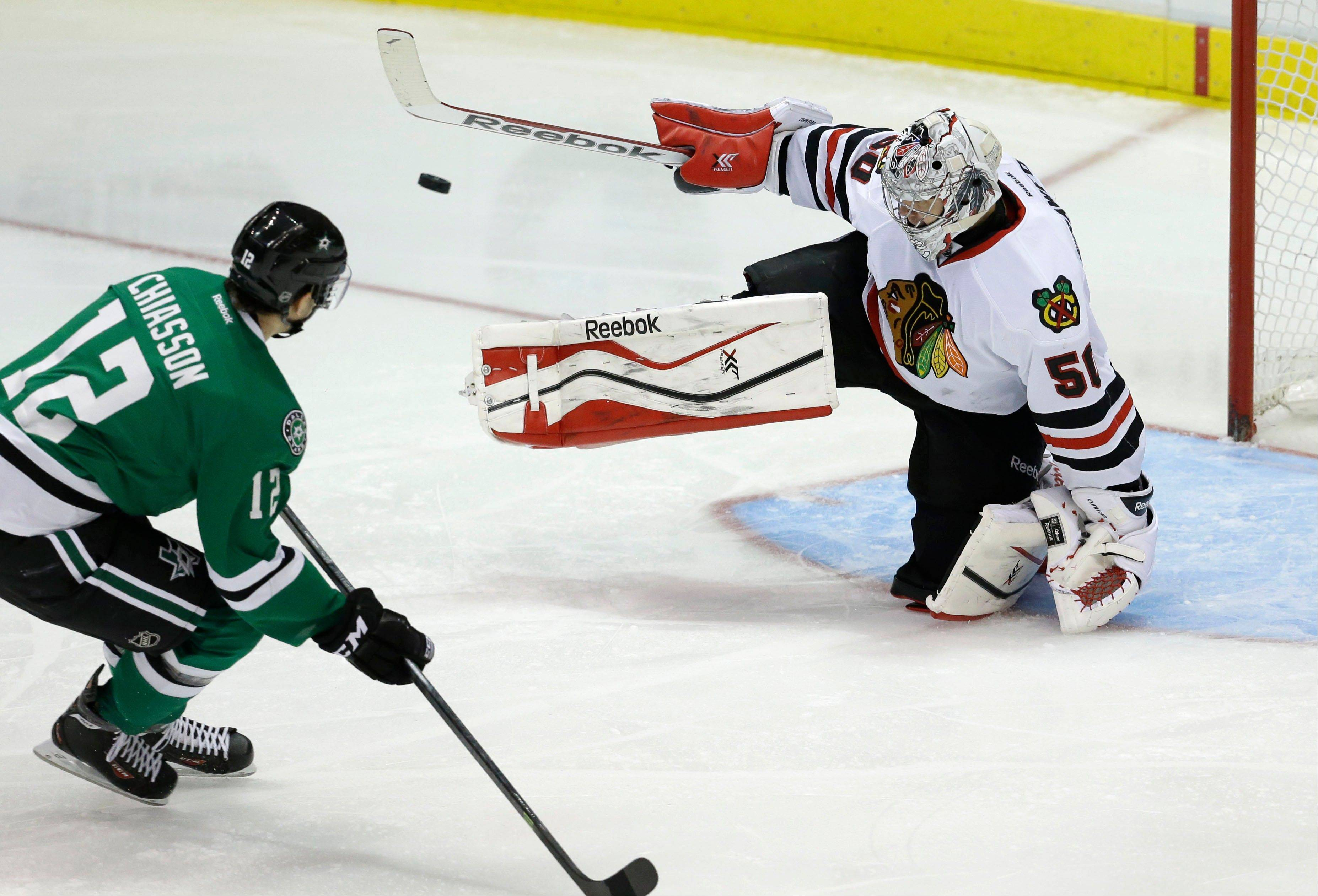 The Stars' Ray Whitney misses a penalty shot against Hawks goalie Corey Crawford during the second period Friday.