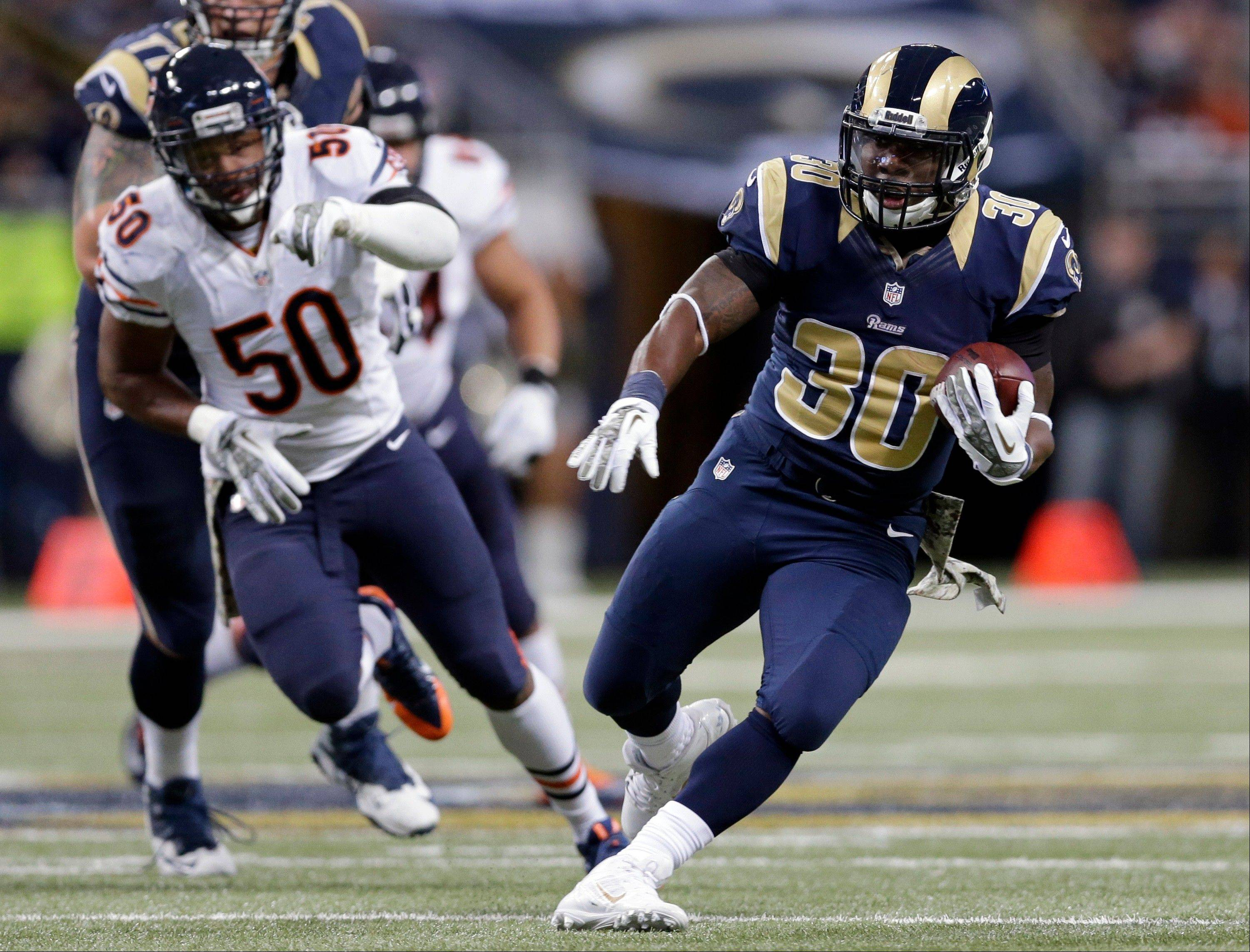 St. Louis Rams running back Zac Stacy, right, runs for a 35-yard gain as Chicago Bears linebacker James Anderson (50) pursues during the first quarter of an NFL football game on Sunday, Nov. 24, 2013, in St. Louis.