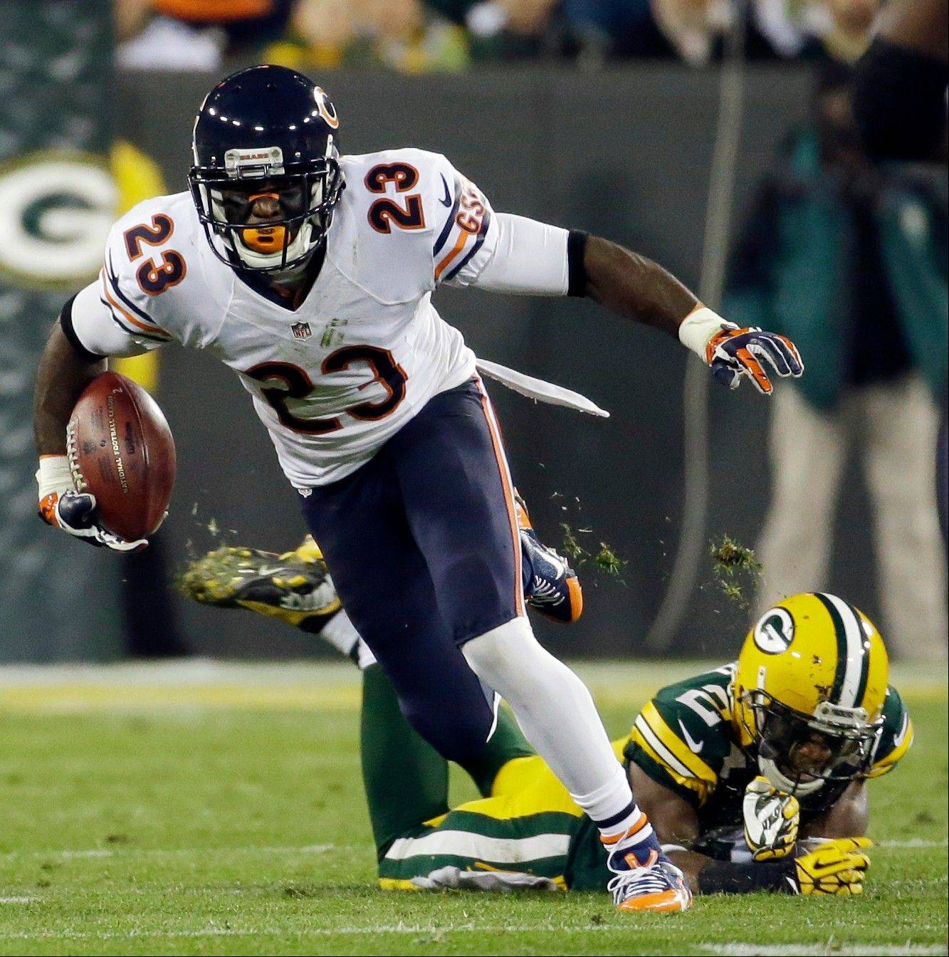 The Bears' Devin Hester tries to get past Green Bay Packers' Jarrett Bush on a punt return in the Nov. 4 game. Back in May, Hester raced a cheetah for a documentary.