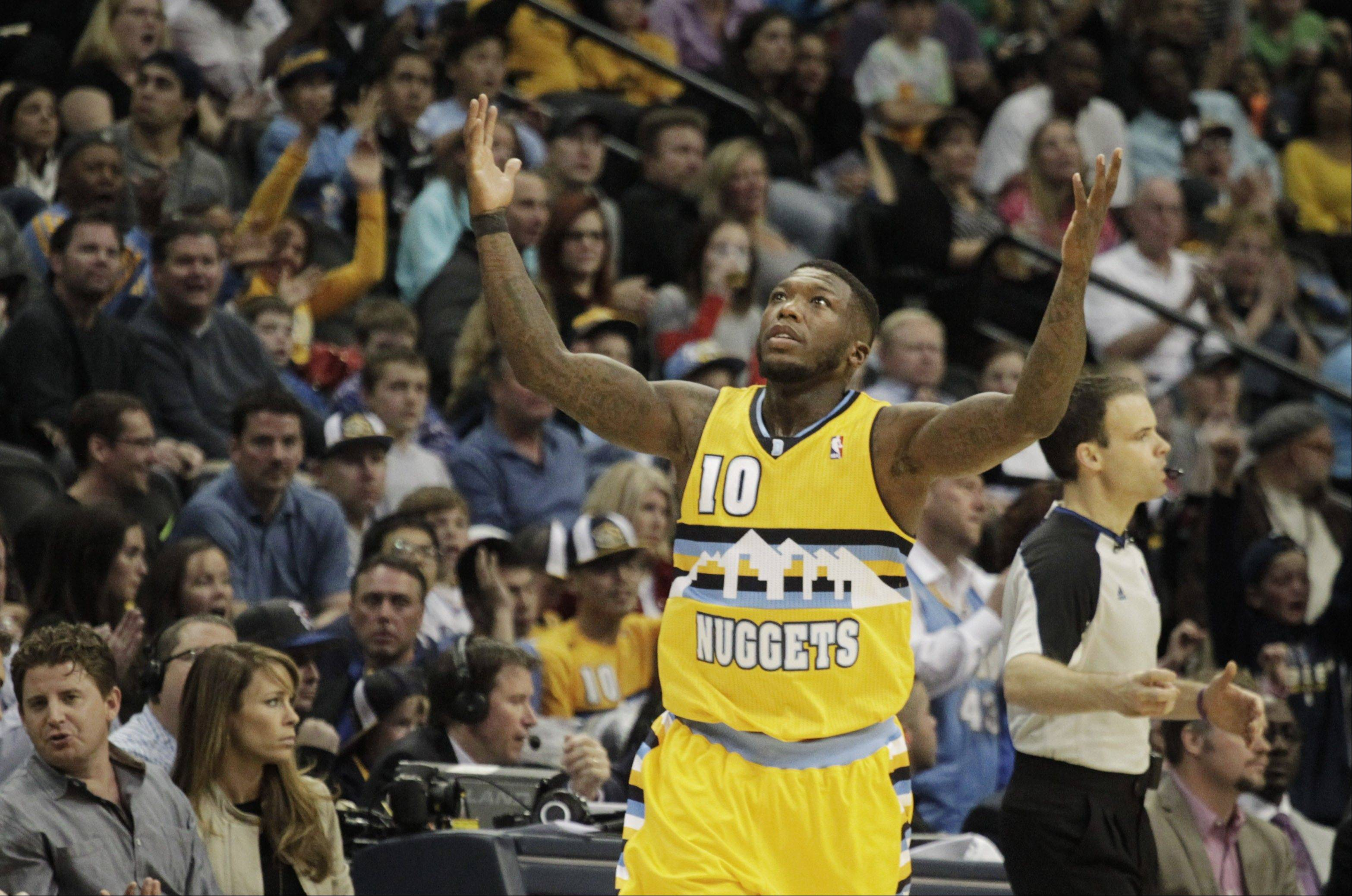 @Casption credit:Associated PressPlaying just 17 minutes per game, point guard Nate Robinson is giving Denver's offense a lift off the bench and averaging about 9 points per game.