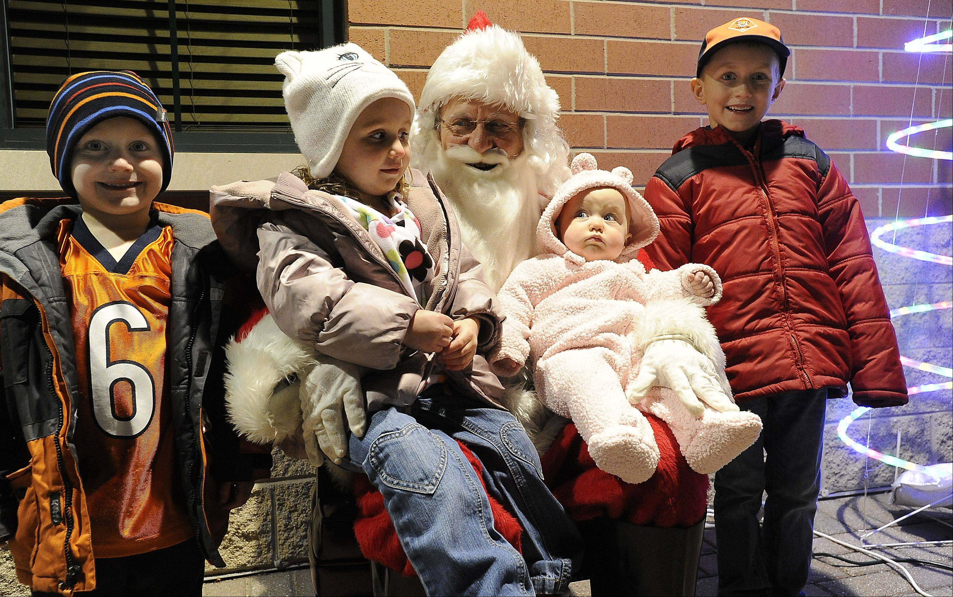 The Mabry children of Prospect Heights — Matthew, 4, Graceleen, 3, Mikayla, 8 months, and Nathan, 7 — visit with Santa at the Prospect Heights tree-lighting held at city hall on Saturday.
