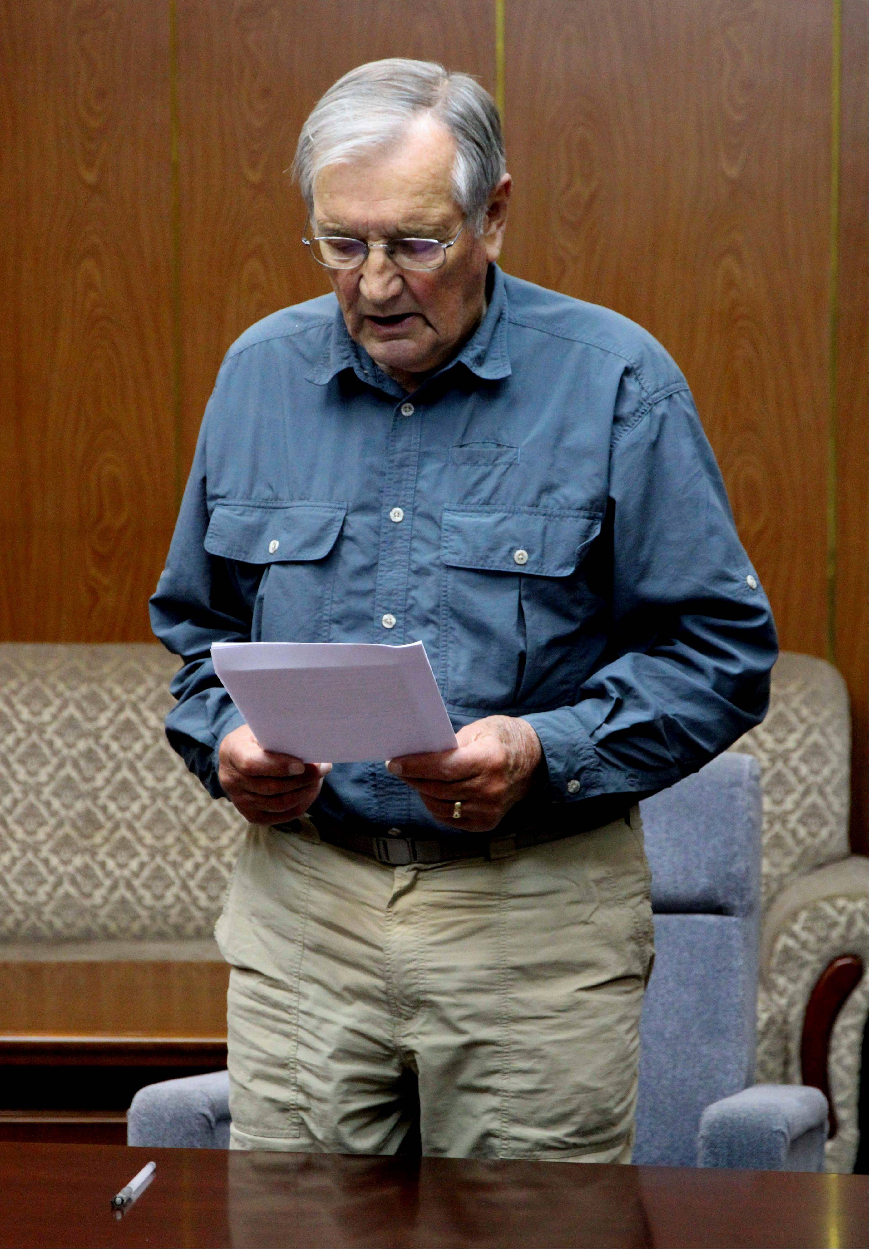 U.S. citizen Merrill Newman, 85, reads a document, which North Korean authorities say was an apology that Newman wrote and read in North Korea.