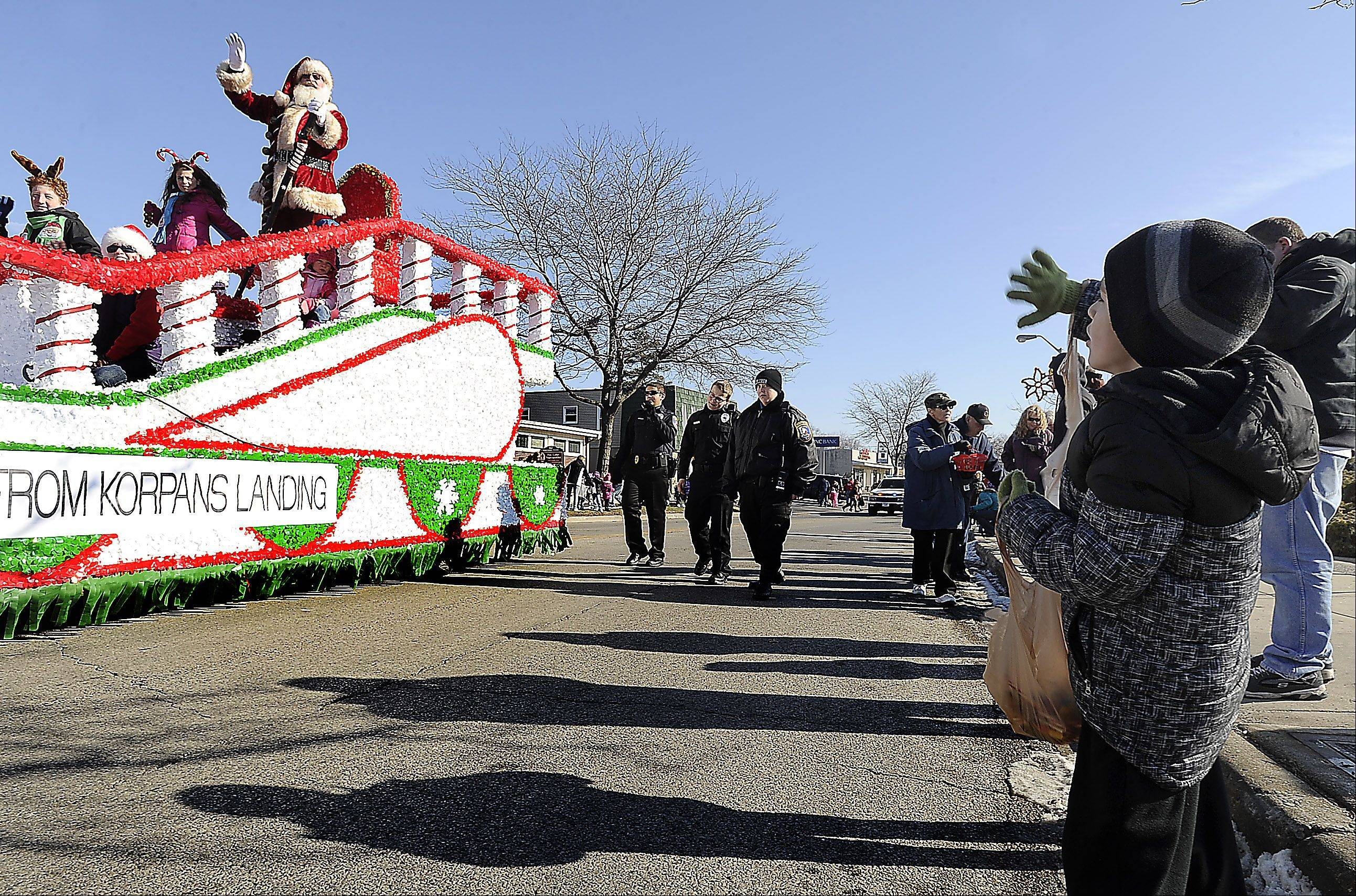 The village of Fox Lake and Korpan�s Landing 57th annual Holiday Parade had plenty of excitement like Santa waving to Joey Glauser, 6, of Fox Lake on Saturday.