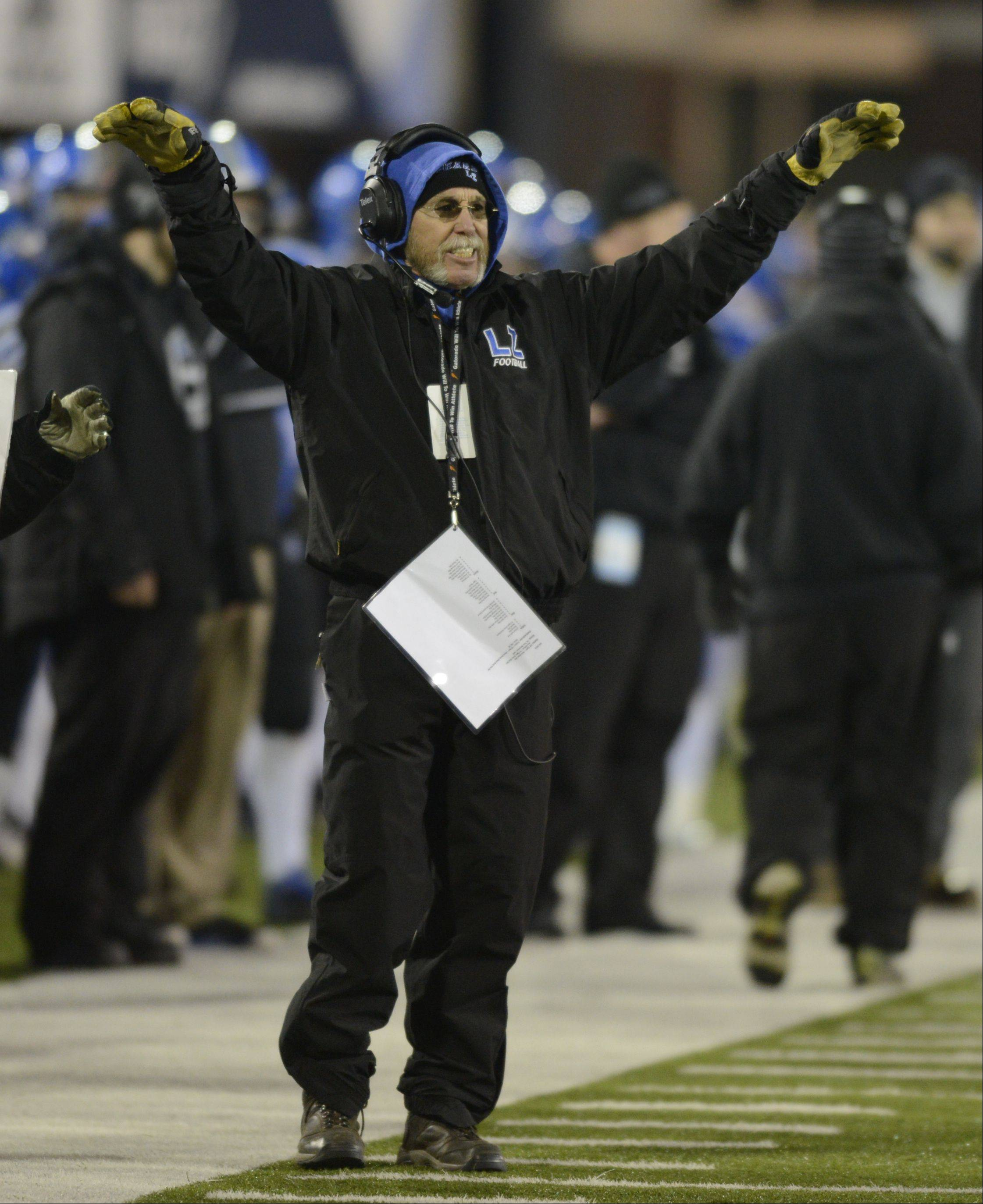 Lake Zurich coach Dave Proffitt follows the action in Saturday�s Class 7A state championship game against Mt. Carmel.