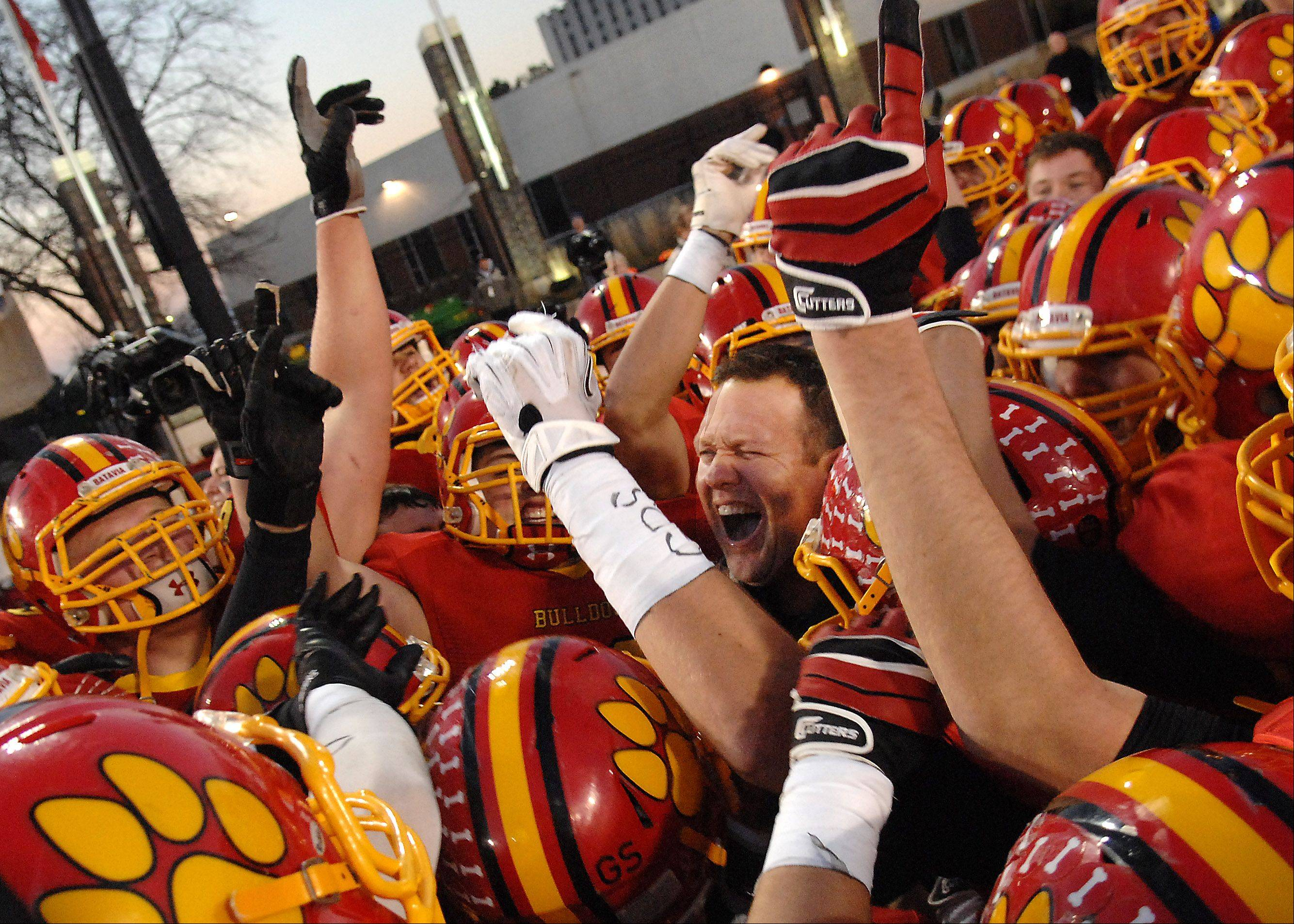 Batavia's head coach Dennis Piron is in the middle of the celebratory scrum after Saturday's 6A championship game in DeKalb.