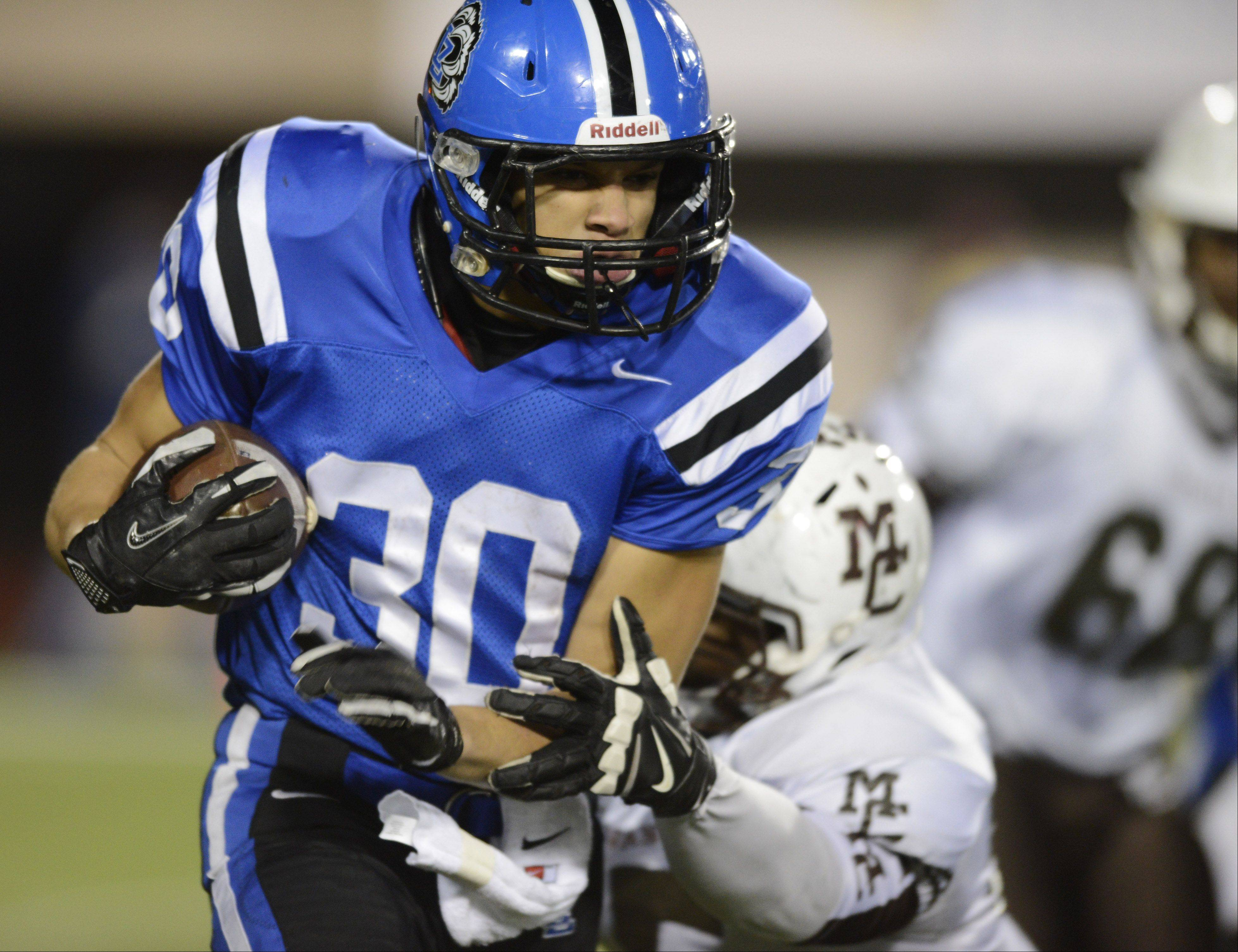 Lake Zurich�s Ben Klett carries the ball against Mt. Carmel during the Class 7A football final in DeKalb Saturday.