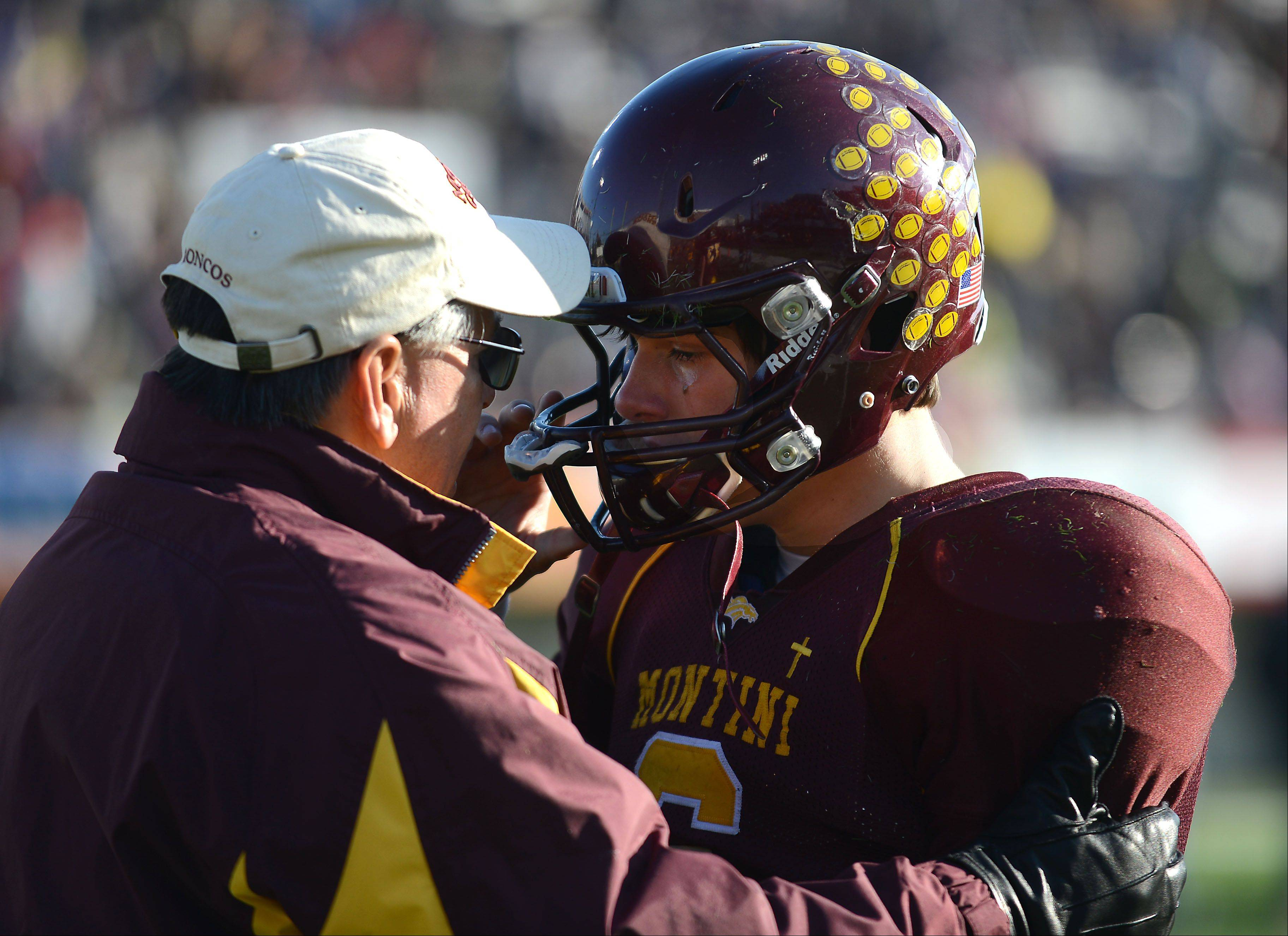 Montini coach Chris Andriano comforts quarterback Alex Willis (6) after Saturday�s Class 5A championship loss to Sacred Heart-Griffin in DeKalb.