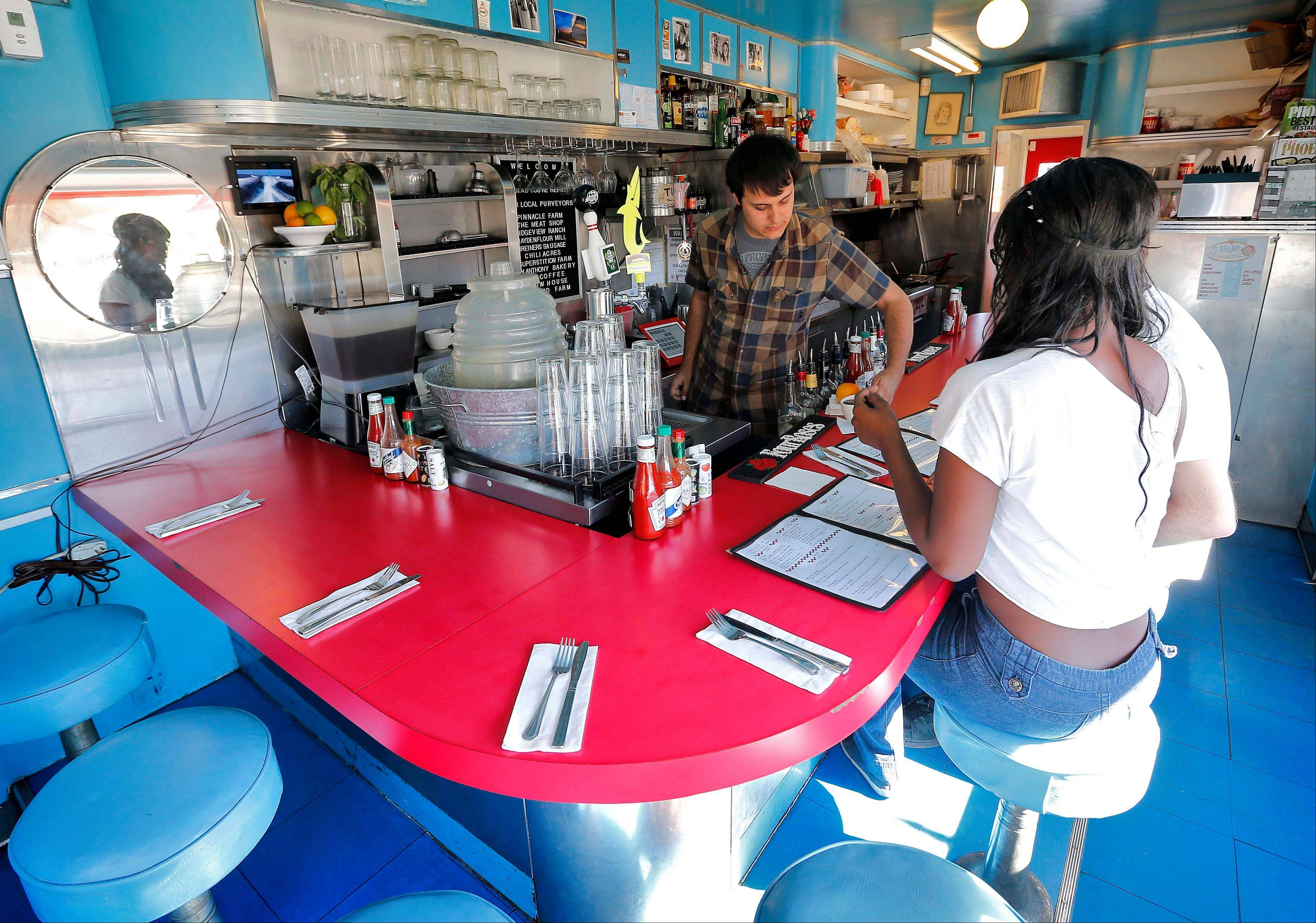 Manager Wayne Coats serves coffee to guests at the Welcome Diner in Phoenix. The 9-stool Valentine Diner was built in 1945 in Wichita, Kan., and moved in 1955 to Williams, Ariz., where it was operated on Route 66 for 25 years.