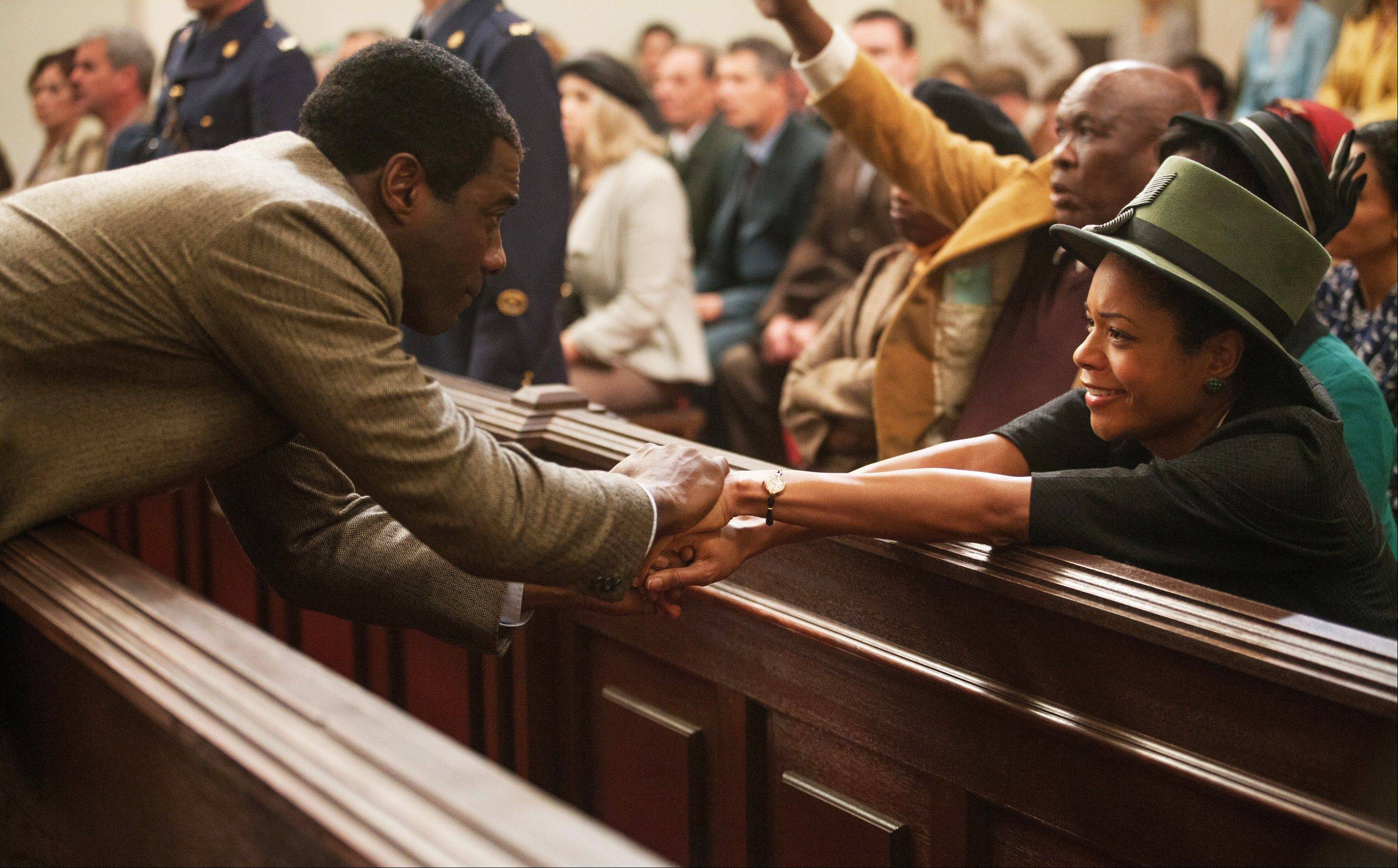 "Idris Elba, left, as Nelson Mandela and Naomie Harris as Winnie Mandela in ""Mandela: Long Walk to Freedom,"" which opened in theaters this weekend."