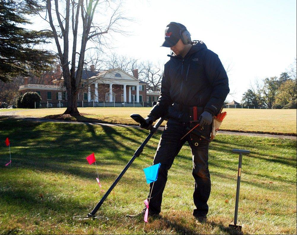 Errol Belda, 26, of Bend, Ore., uses a metal detector to survey artifact-rich land in the shadow of James Madison's Montpelier in Orange, Va. Archaeologists and metal-detecting hobbyists are teaming up to unearth the history that lies beneath the 2,650-acre Virginia estate dating back to the 18th century.