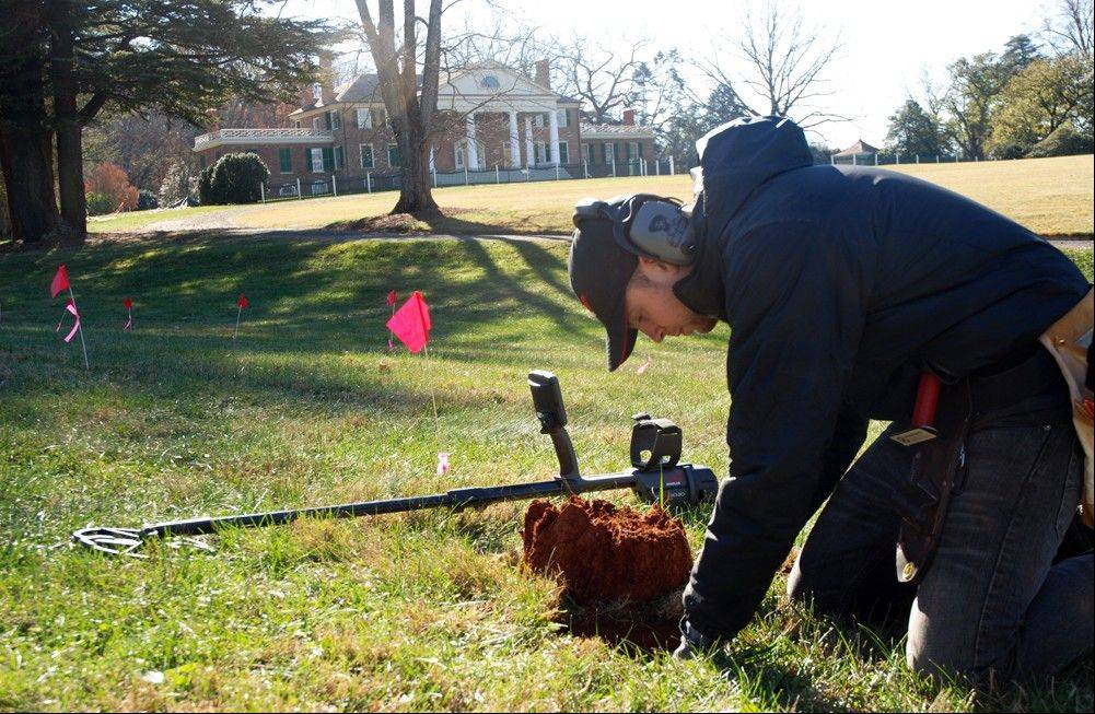 Errol Belda of Bend, Ore., digs for an artifact after using a metal detector to survey land in the shadow of James Madison's Montpelier in Orange, Va. The blips and beeps of the high-tech devices have helped rediscover historic sites on the plantation, including slave quarters, Civil War camps, a blacksmith's workshop and old tobacco barns.