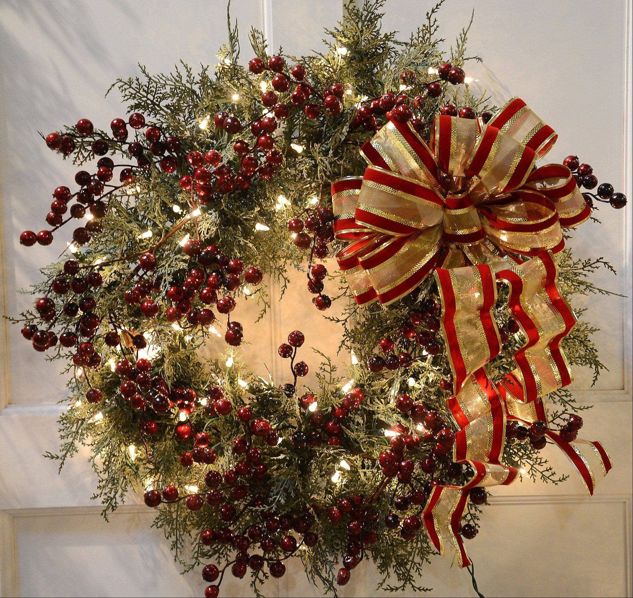 Treetime Christmas Creations sells artificial trees and holiday decorations, including this cedar wreath with weather resistant bow and berries.