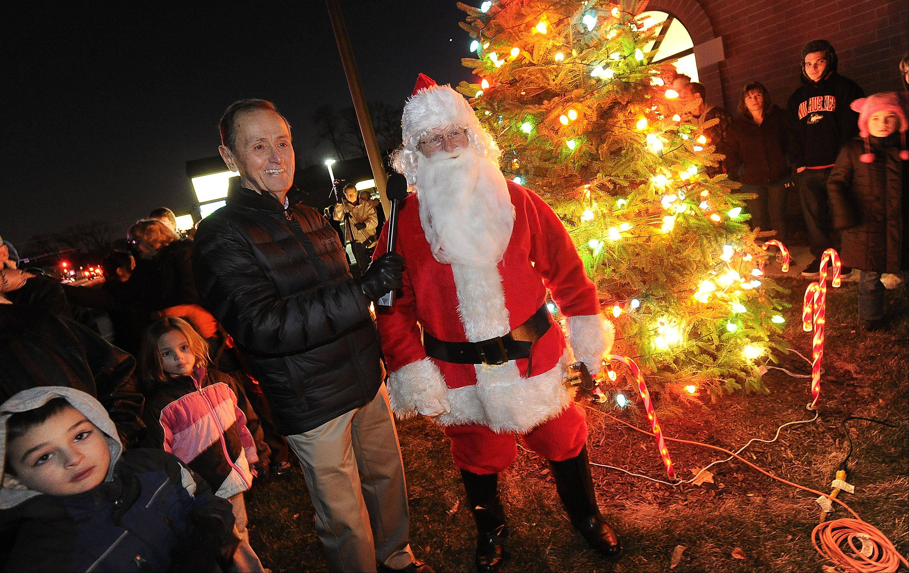 Mayor Nick Helmer and Santa celebrate the holidays at the Prospect Heights tree-lighting held at city hall on Saturday.
