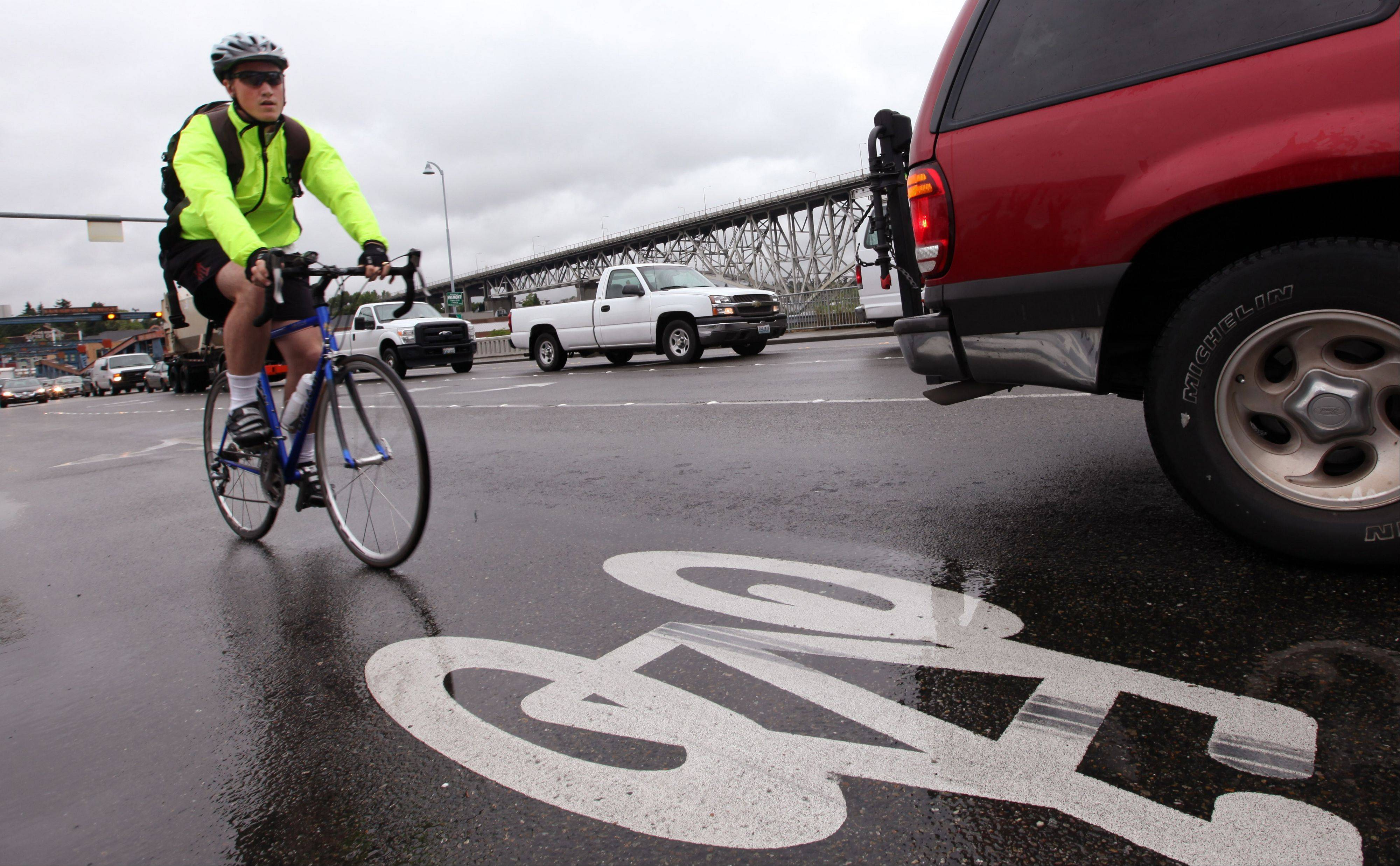 A bicyclist commutes during rush hour past a logo designating a bike route in Seattle. Americans are a mistrustful bunch. Nearly two-thirds say you can't be too careful in de