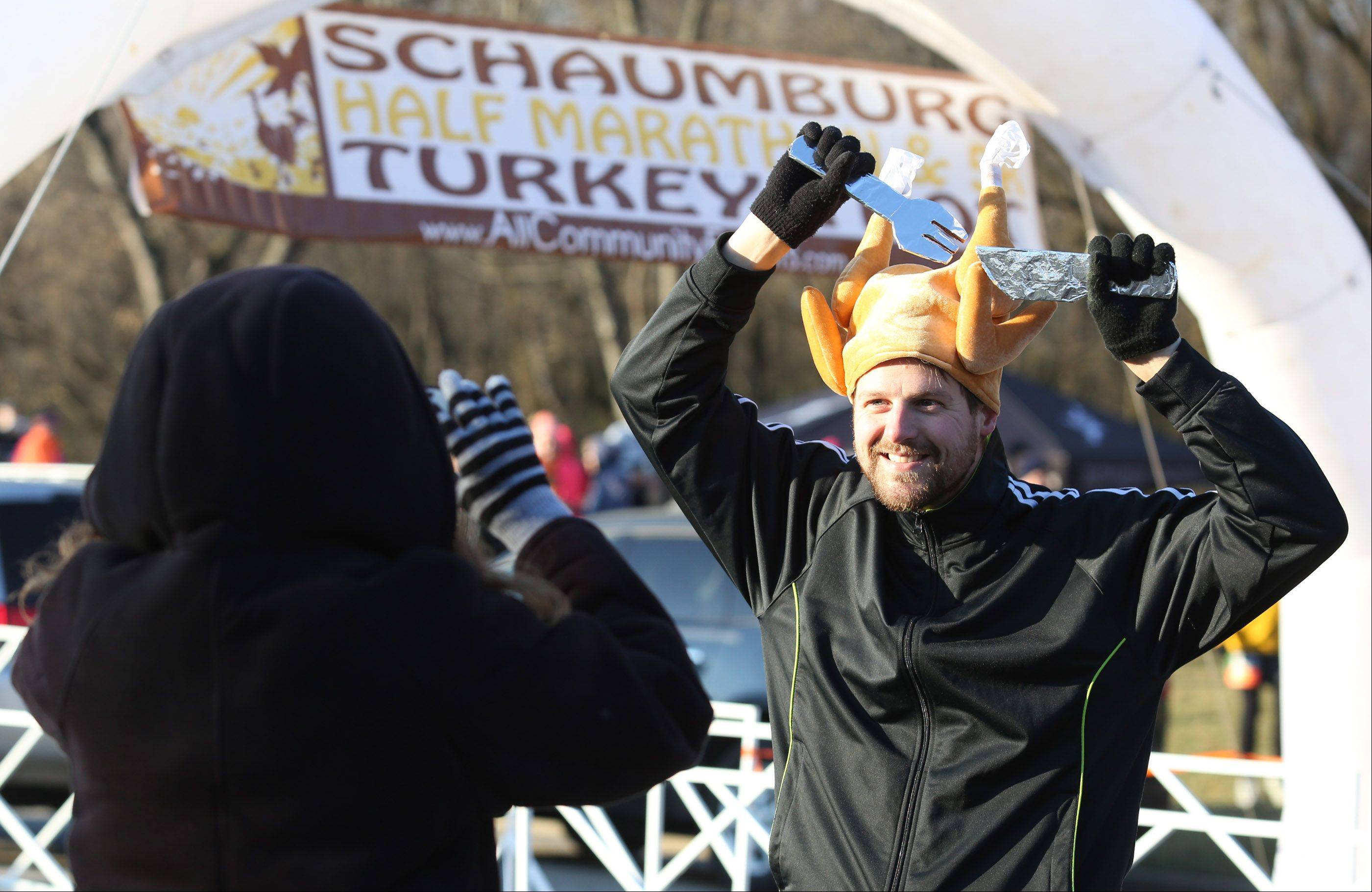 Wesley Dickson of Bolingbrook has his picture taken by his wife, Karen, at the starting line for the Schaumburg 5K Turkey Trot Saturday in Busse Woods near Schaumburg.