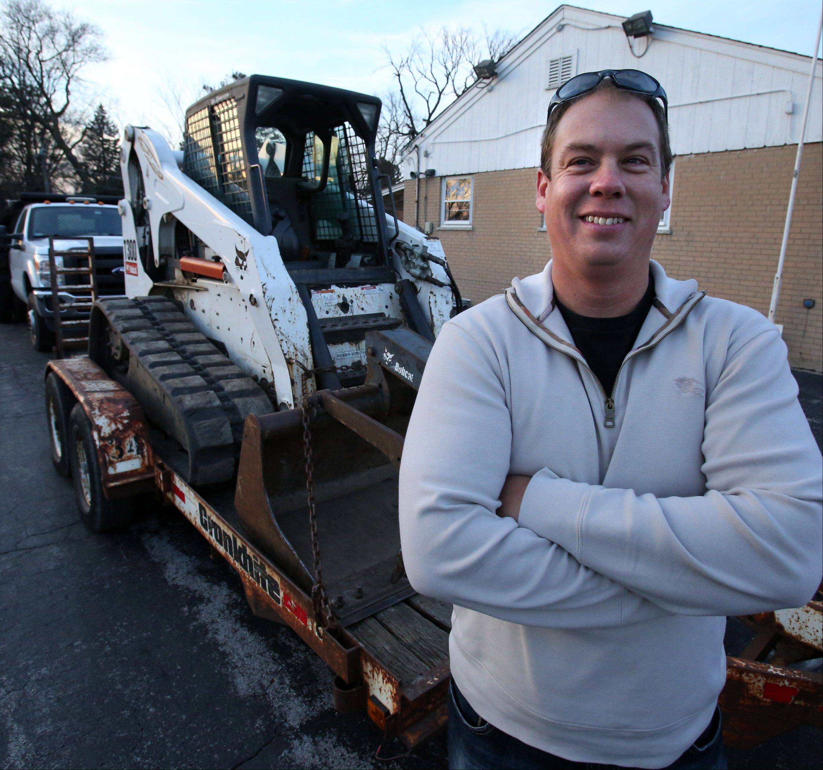 North Village Group CEO Sean Sandona with construction equipment in Des Plaines which he says his company is taking to tornado-ravaged Washington on Saturday.