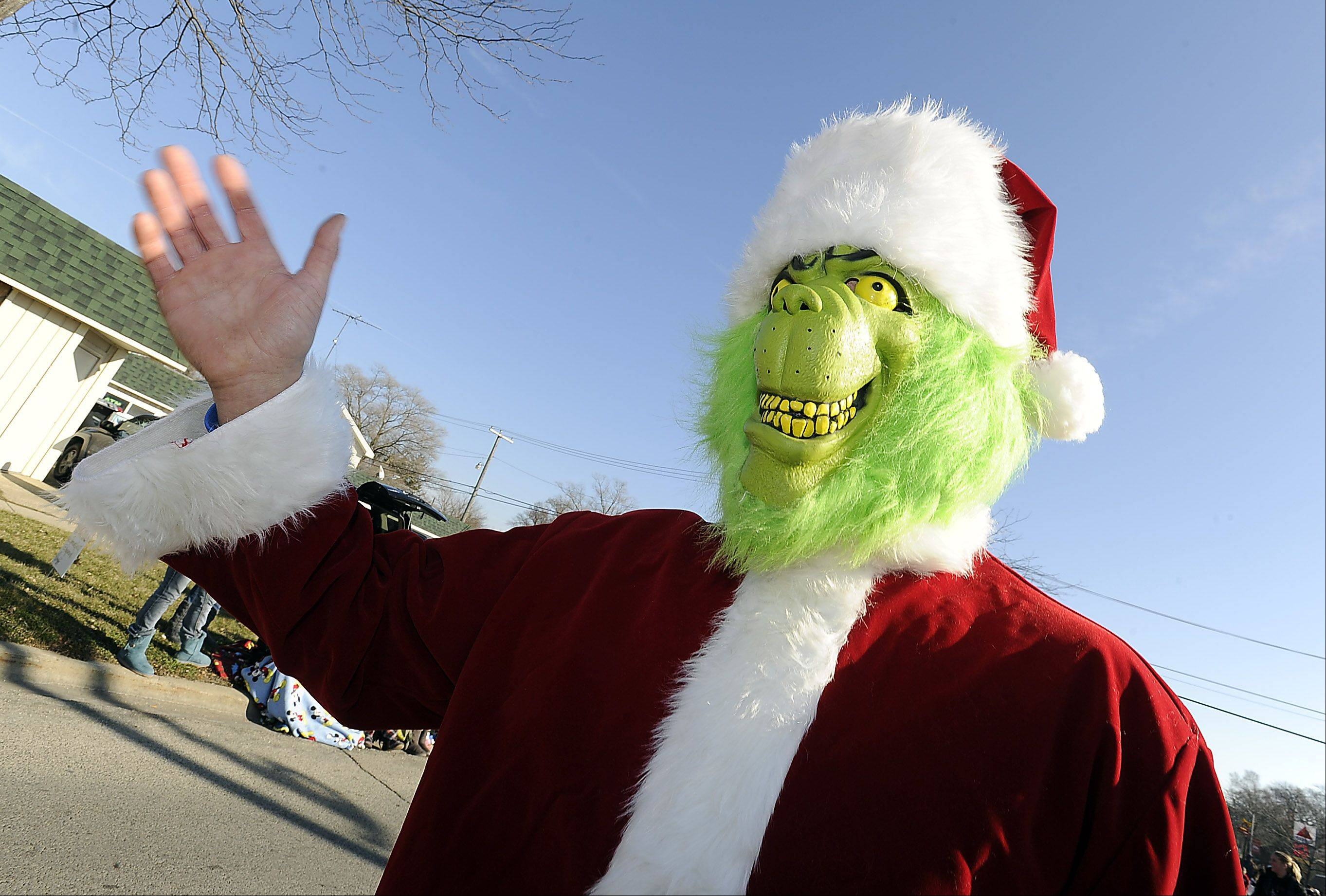 The Grinch who stole Christmas showed up at the village of Fox Lake and Korpan's Landing 57th annual Holiday Parade. Played by Dan Kattner of Fox Lake, he didn't steal the smiles off the hundreds of kids' faces as they waited for Santa.