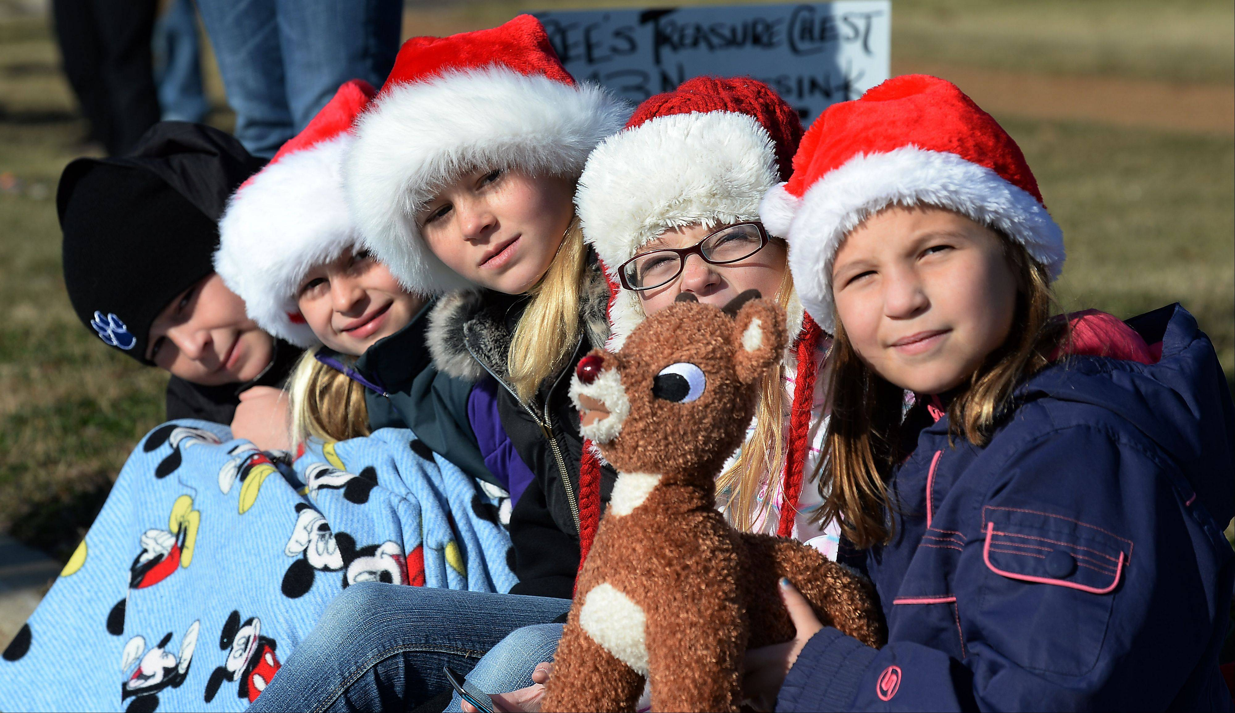 The village of Fox Lake and Korpan's Landing 57th annual Holiday Parade kicks off with Braidy Beagle, 10, Ali Beagle, 8, Peyton Bannon, 11, Annie Willis, 10, and Katie Beagle, 8, all of Spring Grove watching for the star of the show, Santa, to show up on Saturday.
