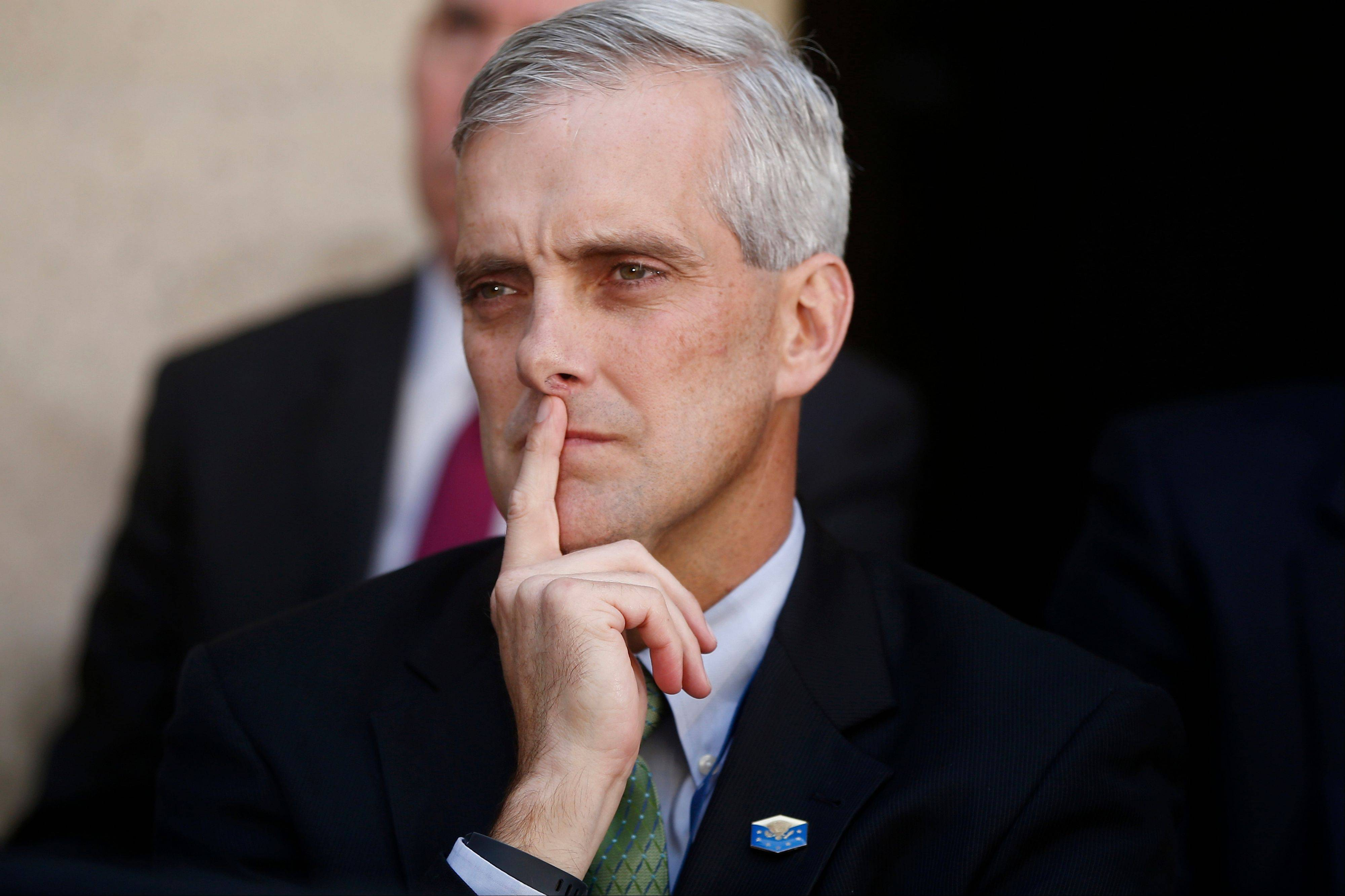 White House Chief of Staff Denis McDonough listens as President Barack Obama speaks at FBI Headquarters in Washington. McDonough has been pushed to the edge by health care advocates anxious over the disastrous rollout of the health care law.