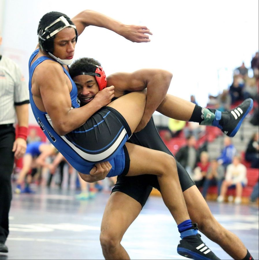 George LeClaire/gleclaire@dailyherald.comHinsdale Central's Juwan Edmond, right, wins over Lake Zurich's Brandon Arleaga at 145-pounds in semifinals at the 23rd annual Moore/Prettyman wrestling tournament on Saturday at Barrington.