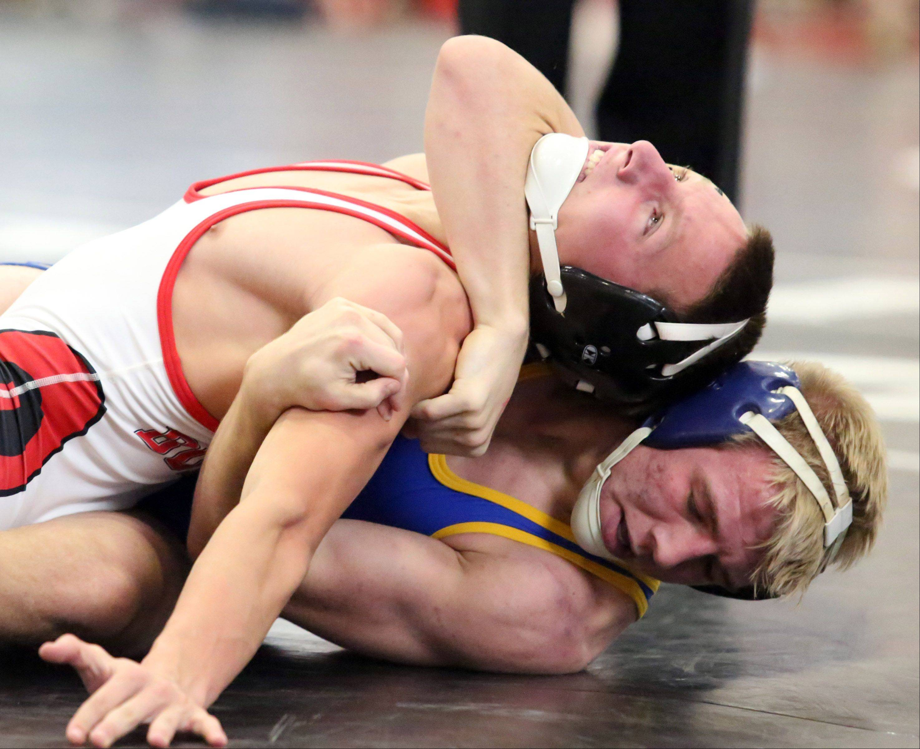 George LeClaire/gleclaire@dailyherald.comGrant's Troy Parent, left, against Johns' Brandon Peshek at 132-pounds in semifinals at the 23rd annual Moore/Prettyman wrestling tournament on Saturday at Barrington.
