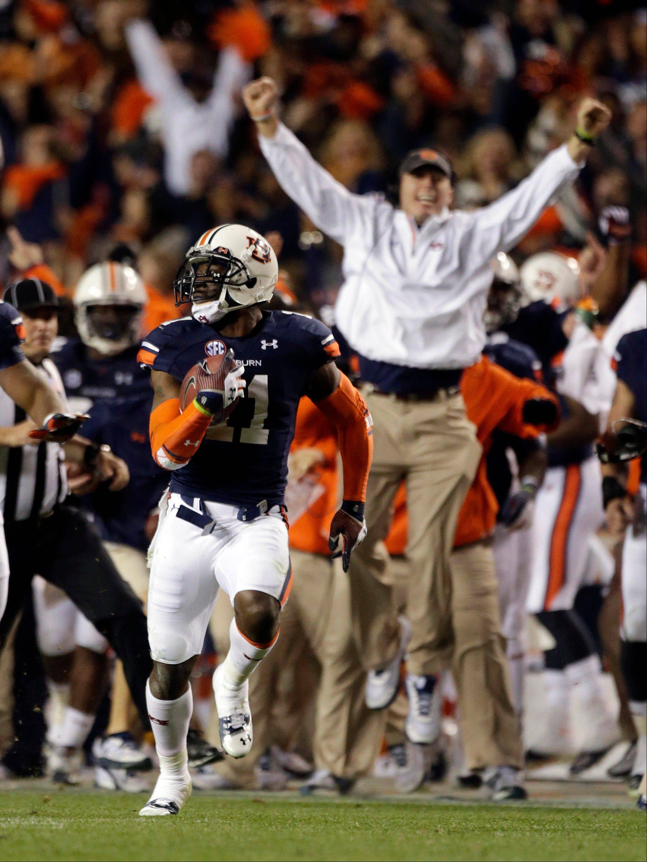 Auburn cornerback Chris Davis (11) returns a missed field goal attempt 100-plus yards to score the game-winning touchdown as time expired in the fourth quarter of an NCAA college football game against No. 1 Alabama in Auburn, Ala., Saturday, Nov. 30, 2013. Auburn won 34-28.