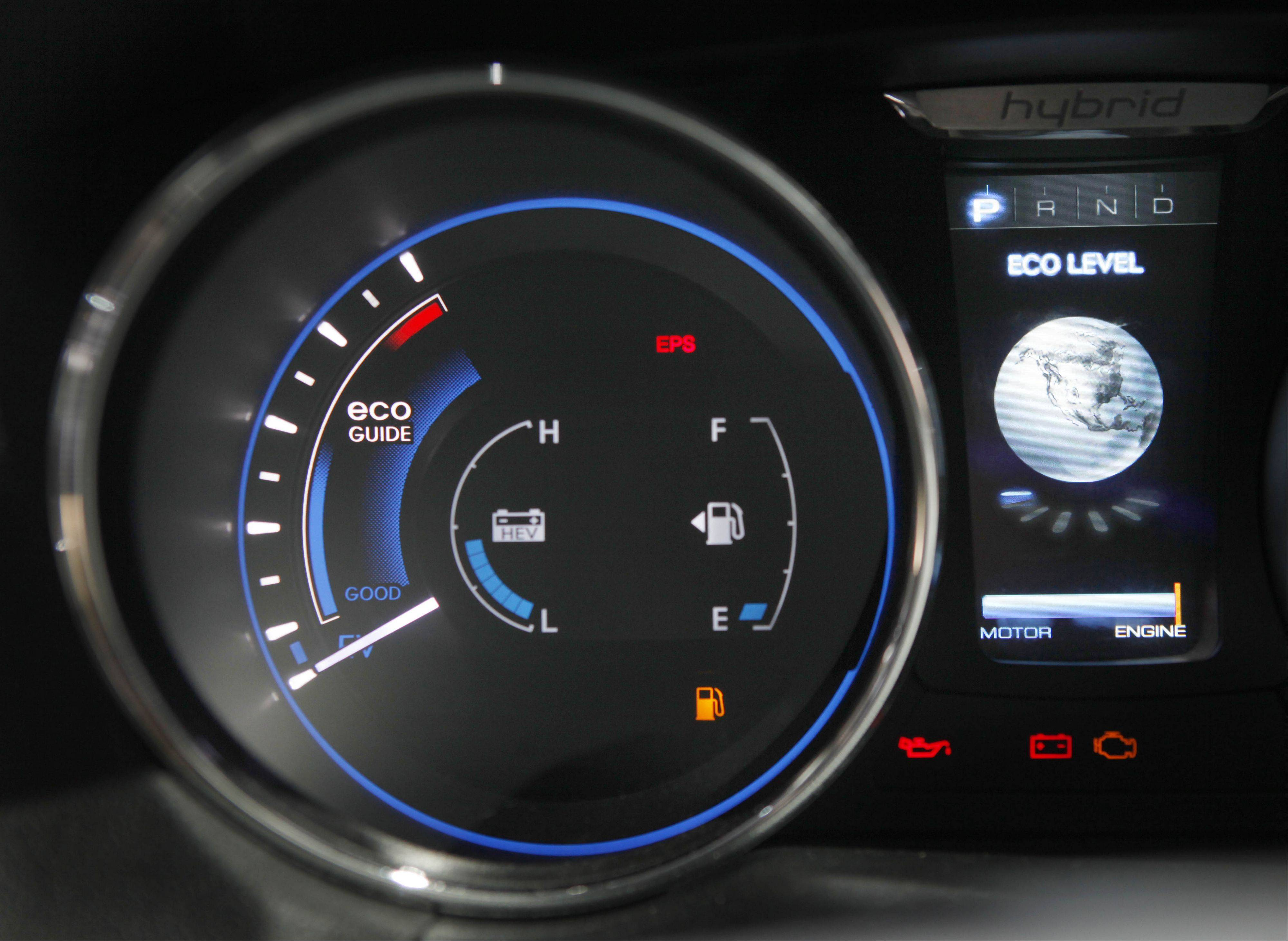 The dashboard on the new Sonata Hybrid displays not only gas levels but economy and electric motor information at the New York International Auto Show in New York in 2010. All of it contributes to the true gas mileage.