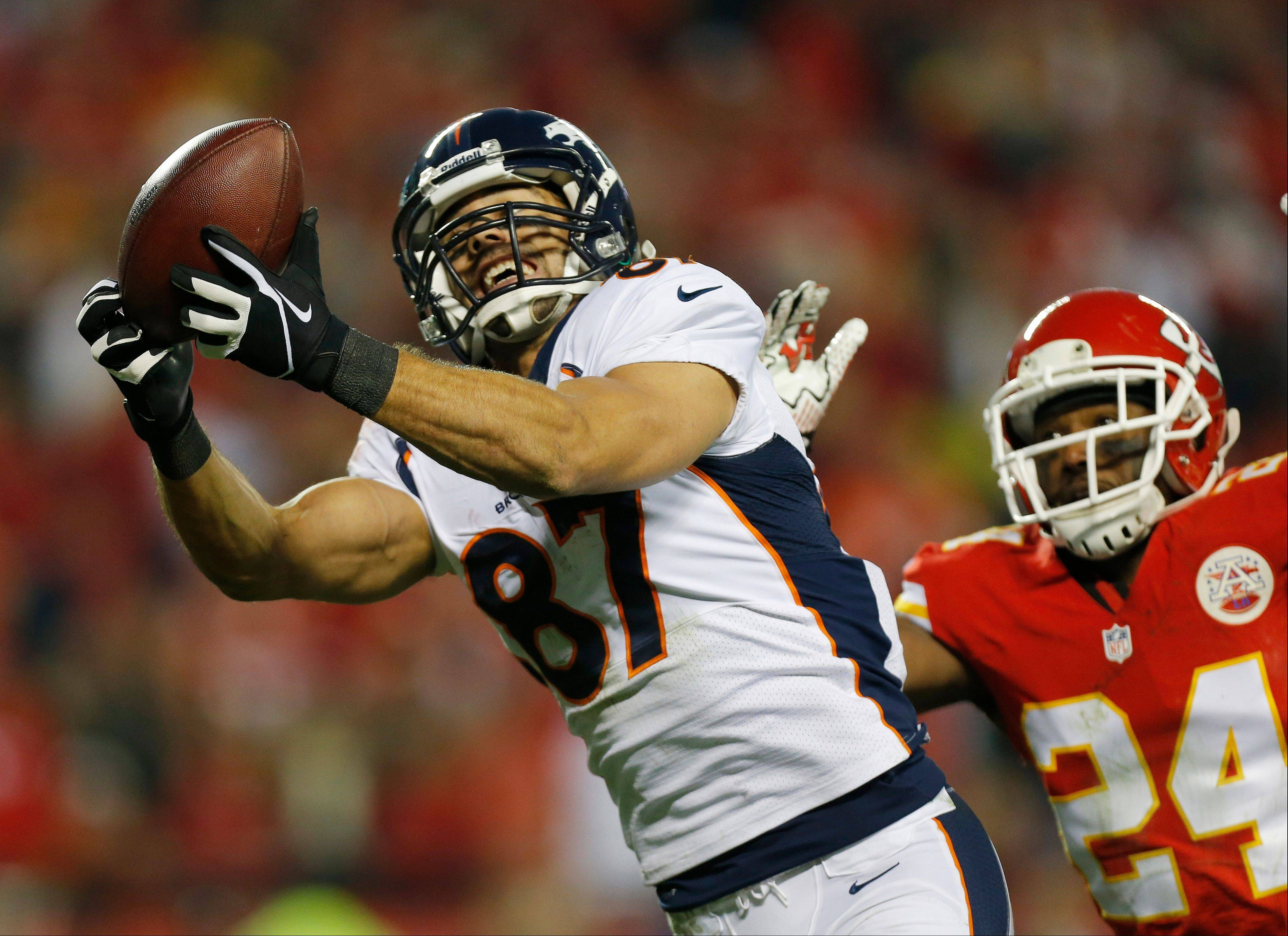 Denver Broncos wide receiver Eric Decker (87) makes a touchdown reception against Kansas City Chiefs cornerback Brandon Flowers (24) during the second half Sunday in Kansas City, Mo.